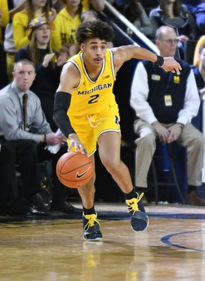 Michigan guard Jordan Poole is among five potential NBA prospects Sports Illustrated writes could help themselves the most in the postseason.