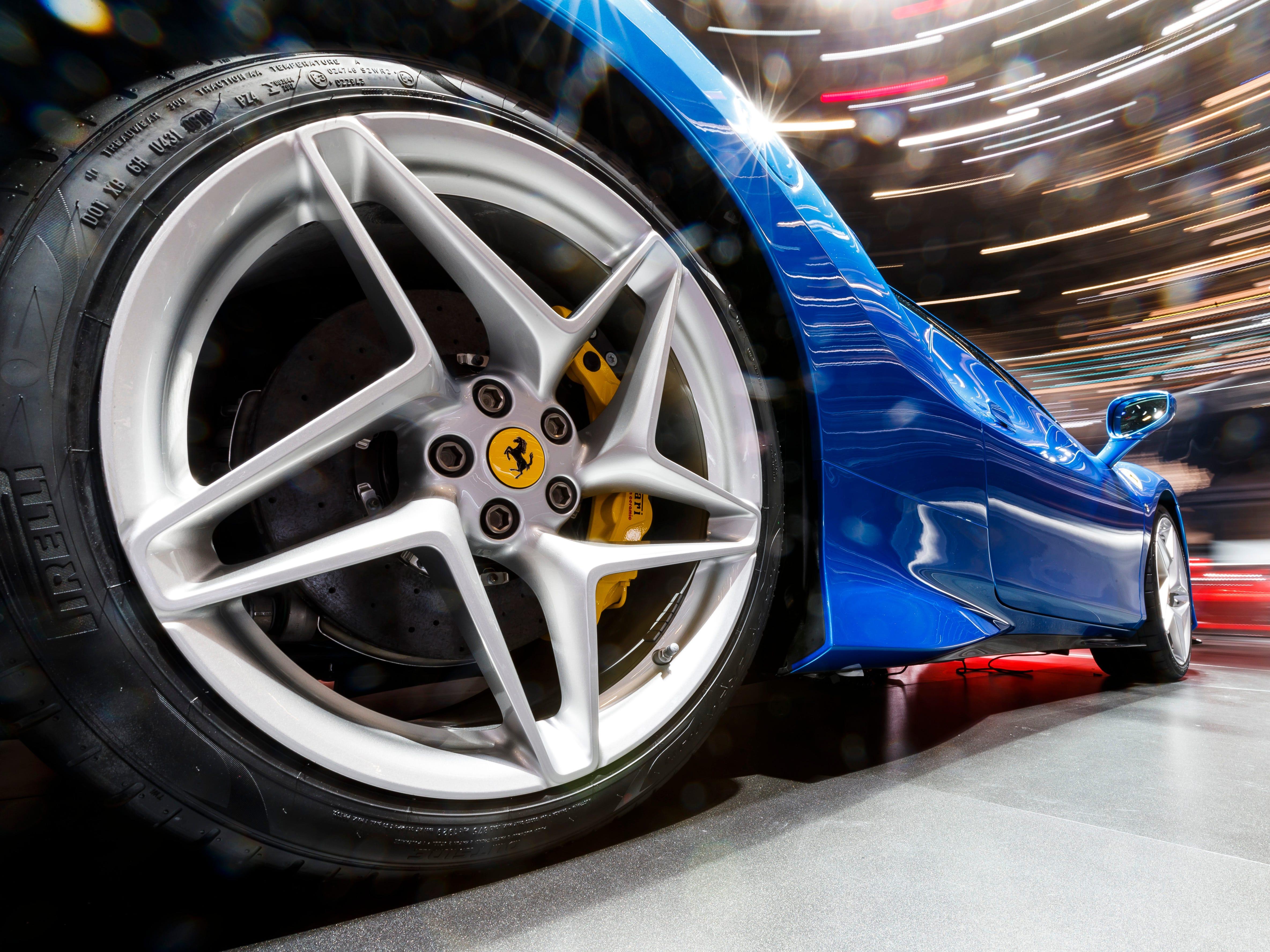 A closeup of the rear wheel on the Ferrari F8 Triturbo