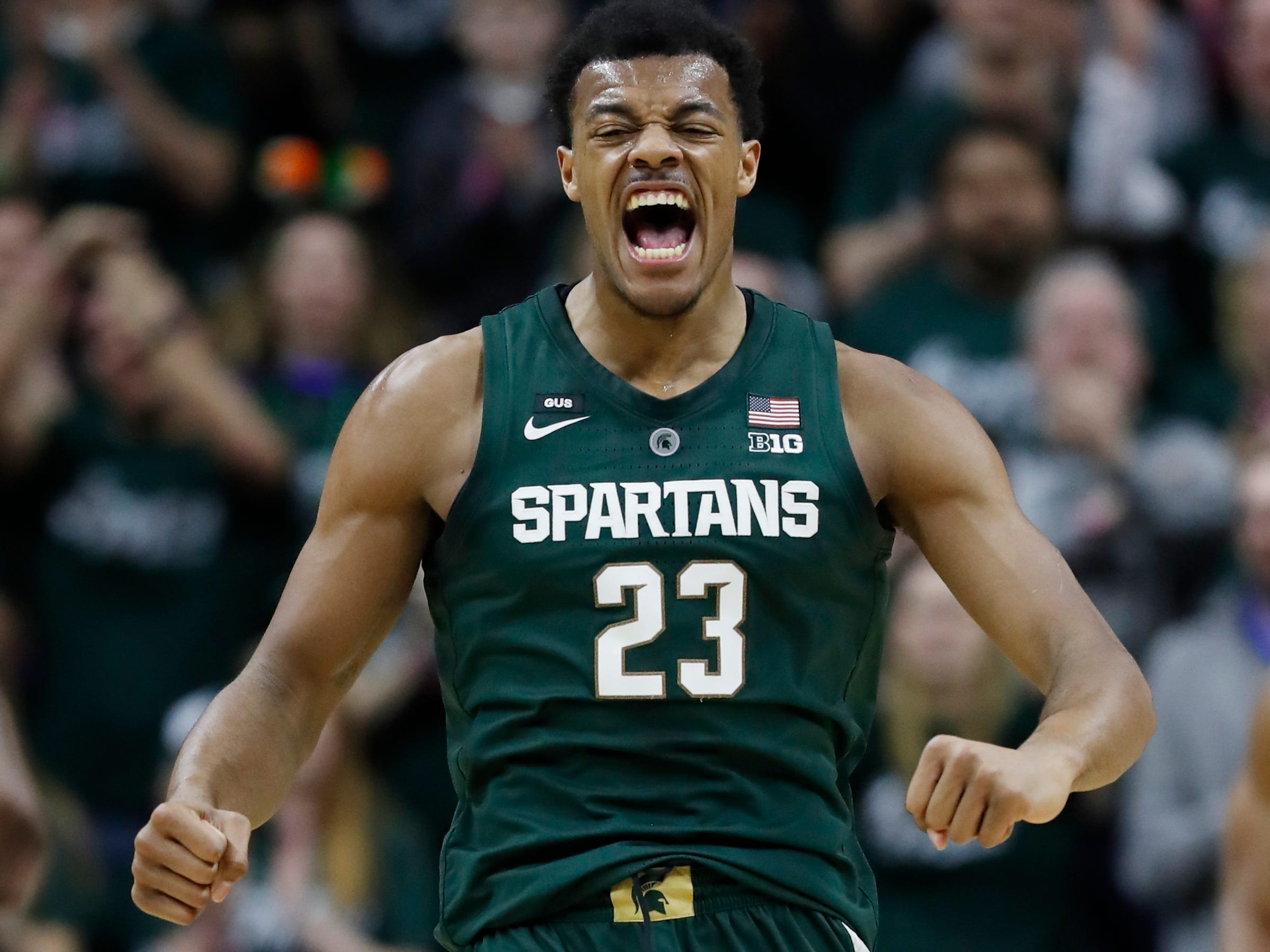 Michigan State forward Xavier Tillman reacts after a basket during the first half of an NCAA college basketball game against Nebraska.