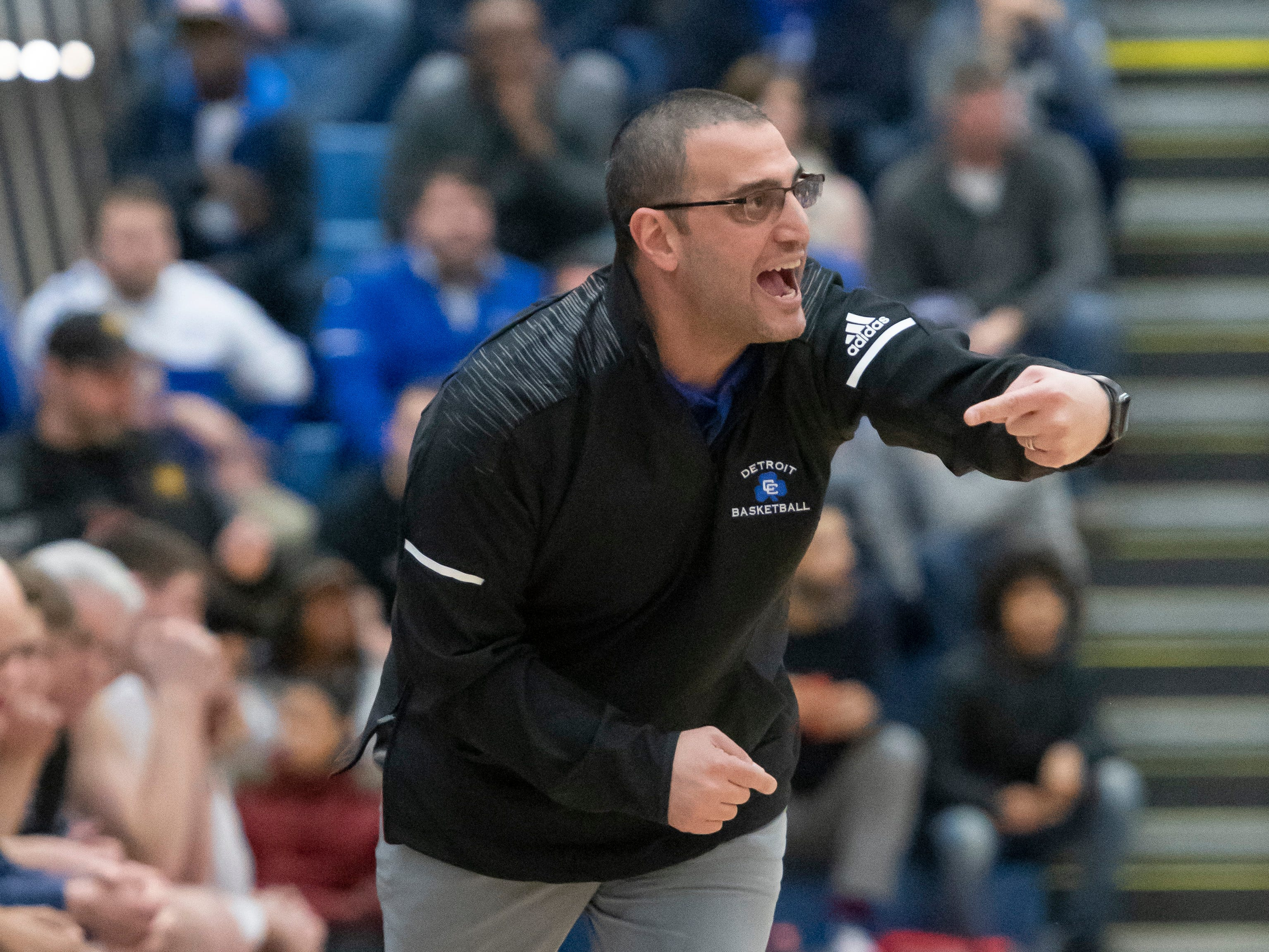 Detroit Catholic Central's head coach Brandon Sinawi yells to his players during the first half.