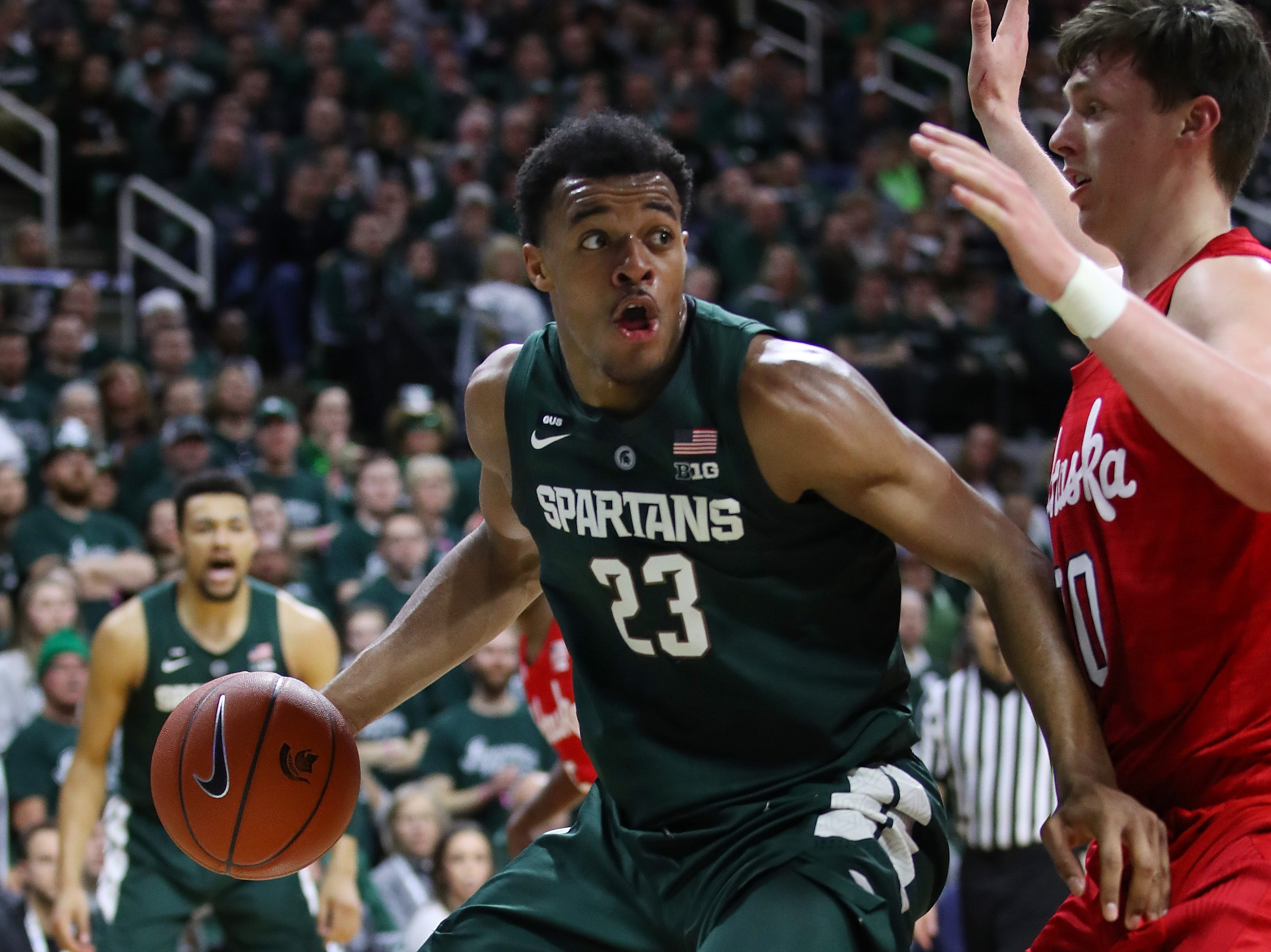 Xavier Tillman (23) of the Michigan State Spartans looks to drive around Tanner Borchardt (20) of the Nebraska Cornhuskers during the first half at Breslin Center on March 05, 2019 in East Lansing, Michigan.