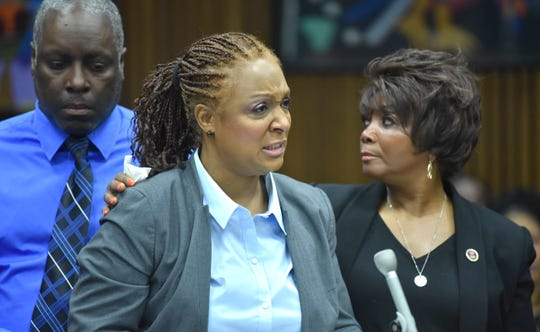 Nikole Flowers, center, mother of Glenn Doss Jr., cries while giving her victim's impact statement as she is comforted by her husband, Ronald Flowers, left, and Doss,Jr.'s grandmother, Beretha Bradley.