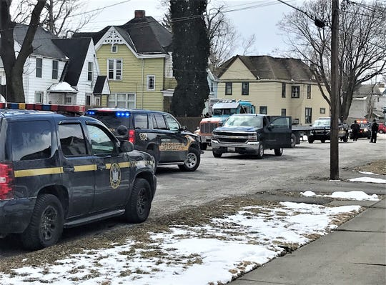 New York State Police and Chemung County Sheriff's Office patrol cars line Catherine Street in Elmira following a high-speed chase Wednesday morning.