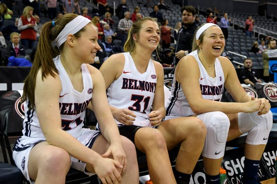 Belmont's Darby Maggard (33), Maura Muensterman (31) and Maddie Wright (55) laugh as they wait to be announced as starters against the Southeast Missouri Redhawks in the first round of the Ohio Valley Conference Tournament at Ford Center in Evansville, Ind., Wednesday, March 6, 2019. The Bruins defeated the Redhawks, 74-65.