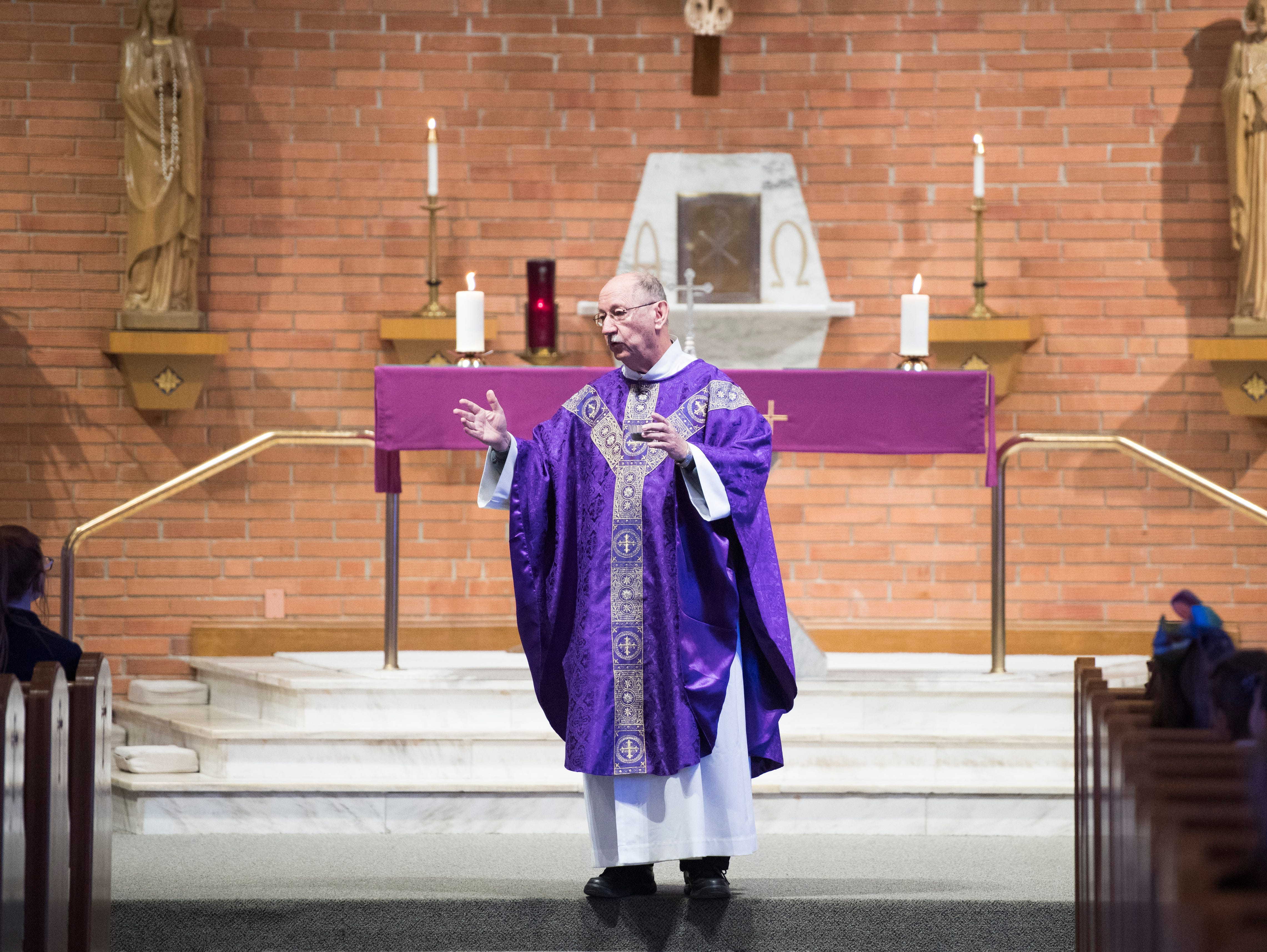 Rev. David H. Nunning speaks about the readings during the Ash Wednesday Mass at Corpus Christi Church Wednesday, March 6, 2019.