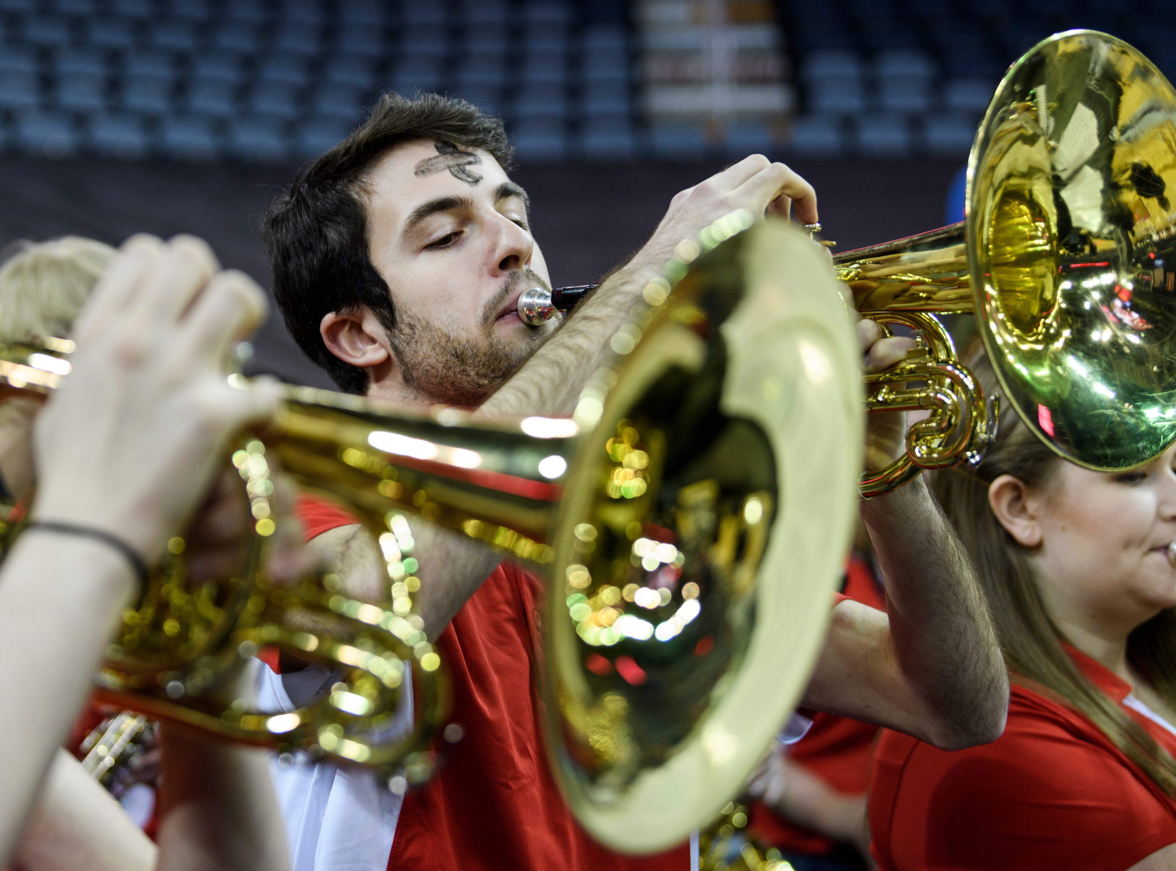 Patrick Ring, a member of Belmont University's Bruin Blast pep band, plays music during the women's basketball team game against the Southeast Missouri Redhawks in the first round of the Ohio Valley Conference Tournament at Ford Center in Evansville, Ind., Wednesday, March 6, 2019. The Bruins defeated the Redhawks, 74-65.