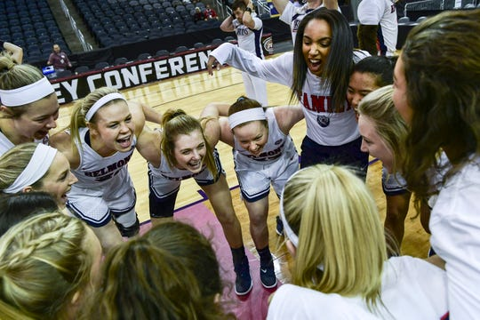 The Belmont Bruins pump themselves up on the court before taking on the Southeast Missouri Redhawks during the first round of the Ohio Valley Conference Tournament at Ford Center in Evansville, Ind., Wednesday, March 6, 2019. The Bruins defeated the Redhawks, 74-65.