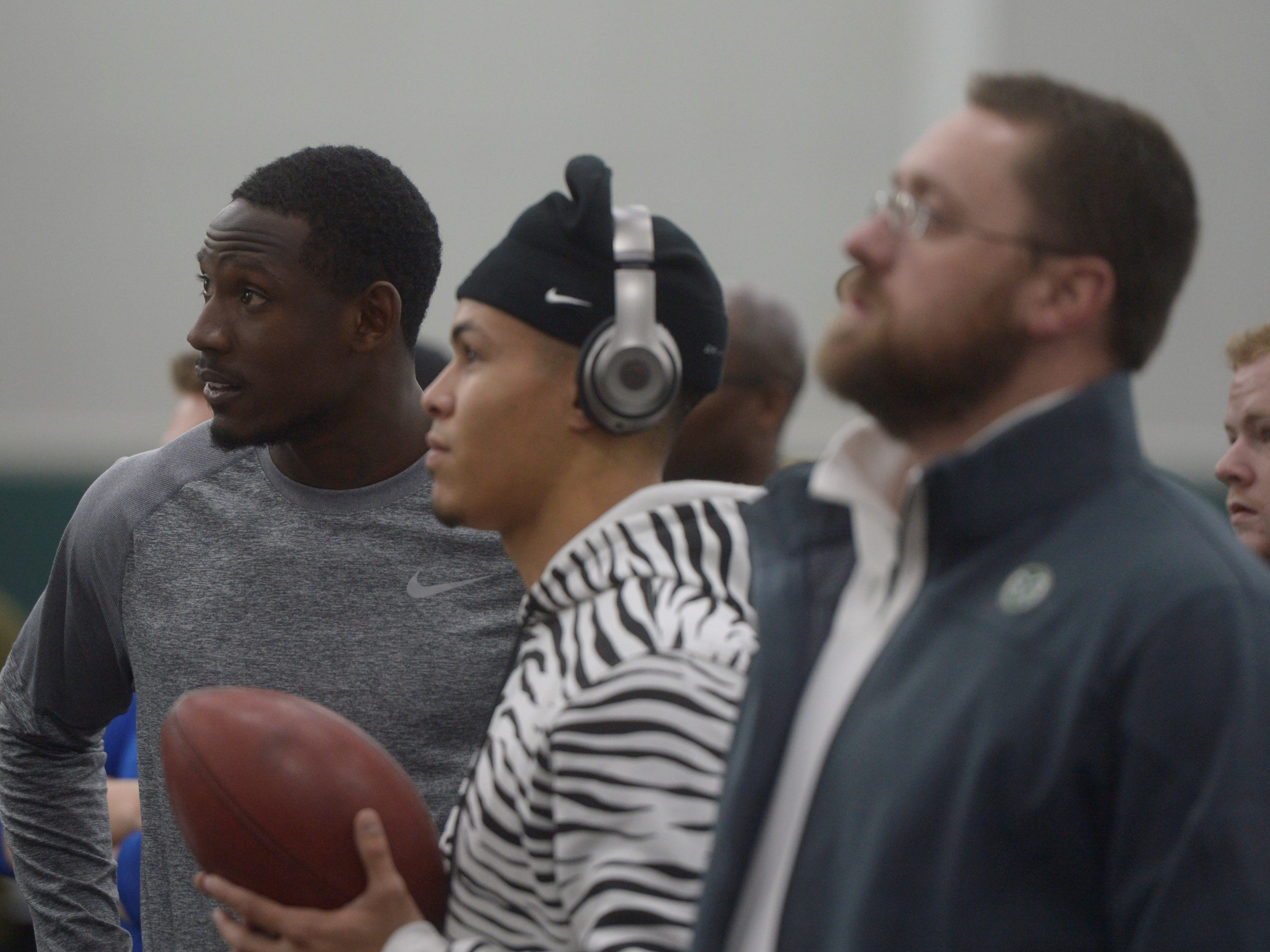 Former Colorado State receivers Preston Williams, left, and Bisi Johnson watch teammates watch teammates participate in CSU's pro day on Wednesday, March 6, 2019.