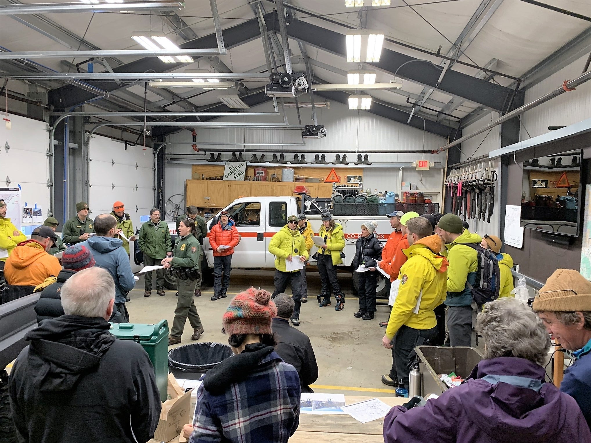 A search crew conducts a briefing before searching for James Pruitt, 70, of Etowah, Tennessee, who is missing in Rocky Mountain National Park.