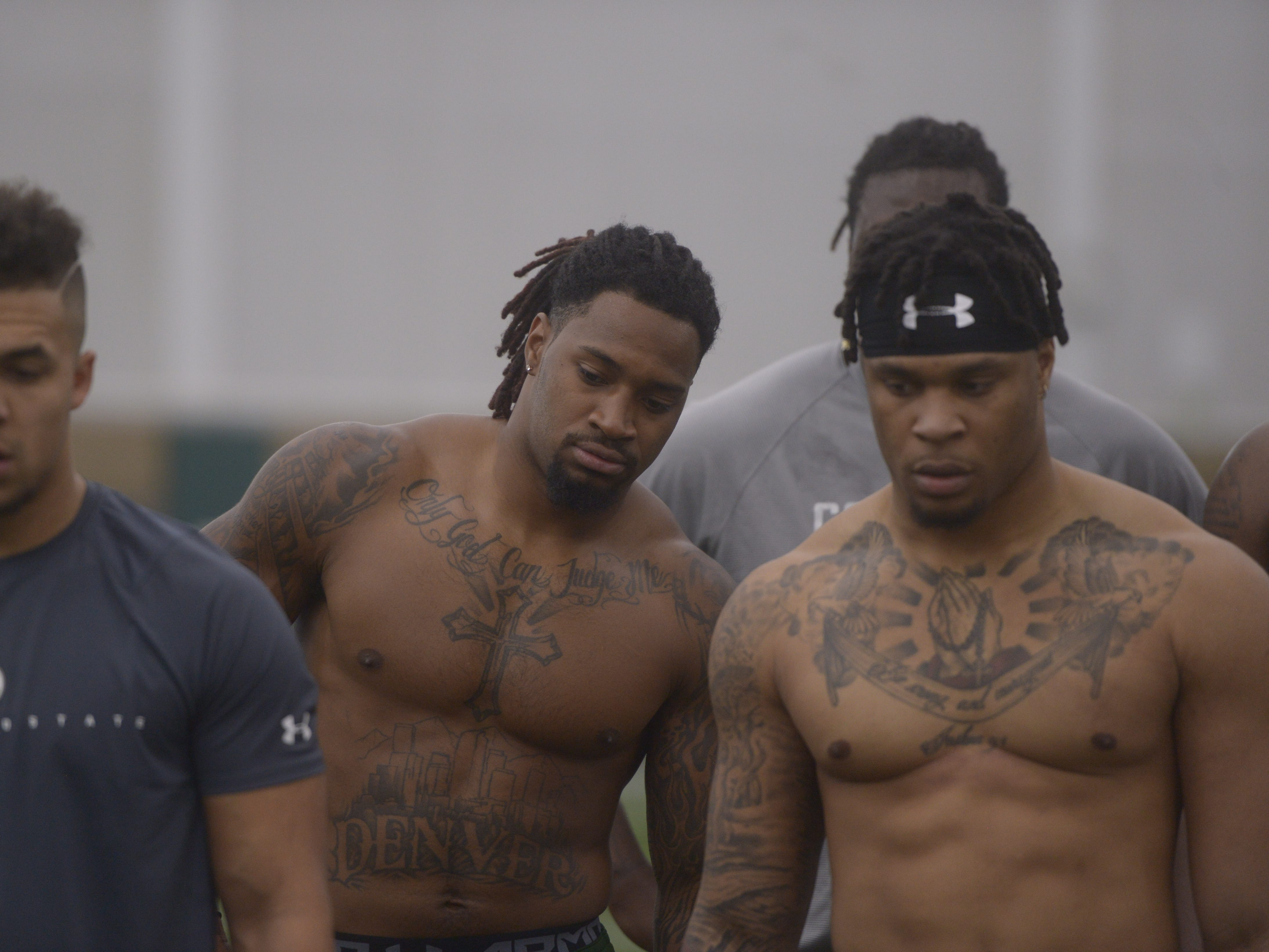 Former Colorado State football players, from left to right, Izzy Matthews, Tre Thomas and Josh Watson watch a scout demonstrate a drill at CSU's pro day in the Indoor Practice Facility on Wednesday, March 6, 2019.