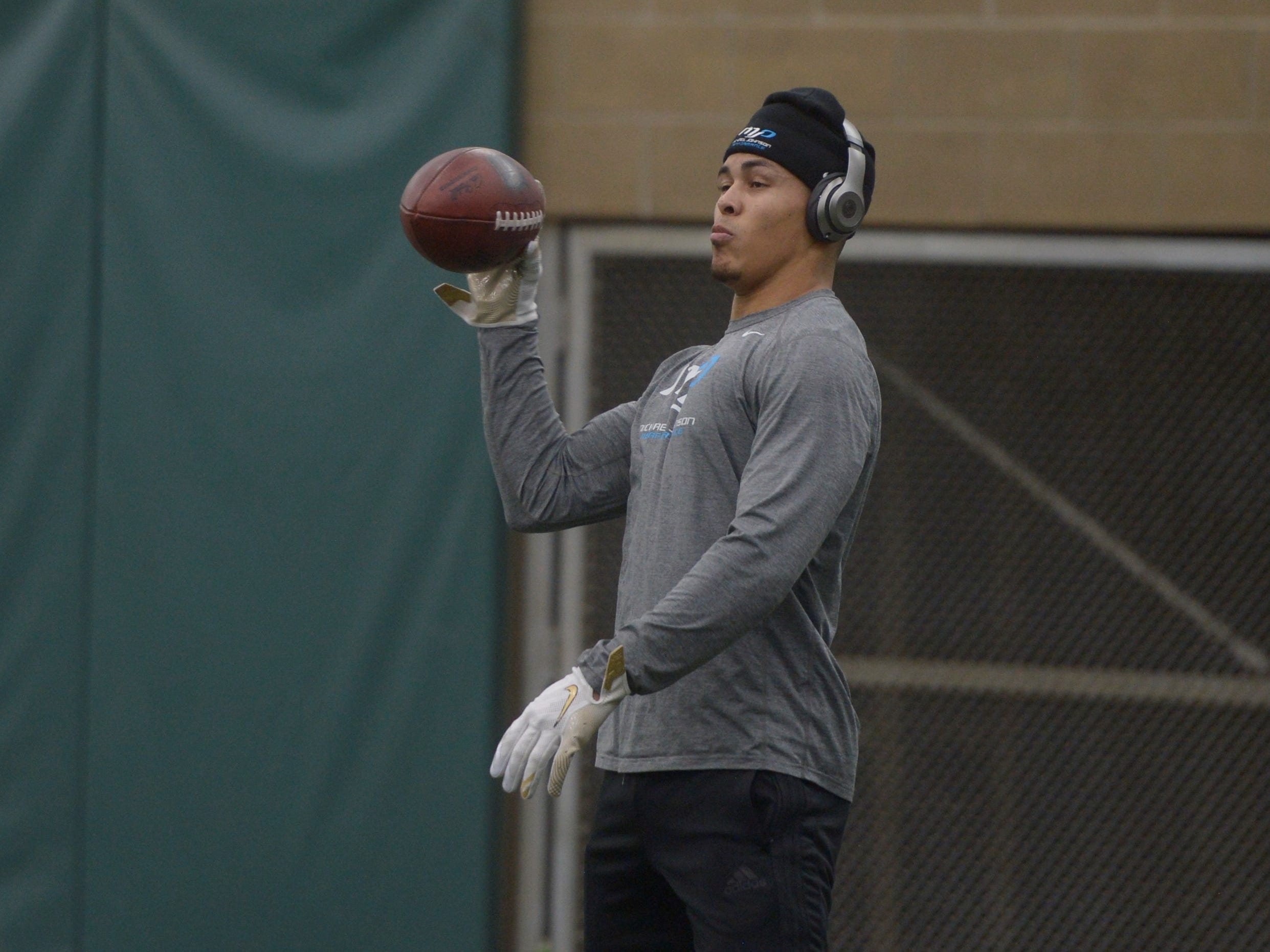 Former Colorado State receiver Bisi Johnson catches passes during warmups at CSU's pro day at the Indoor Practice Facility on Wednesday, March 6, 2019.