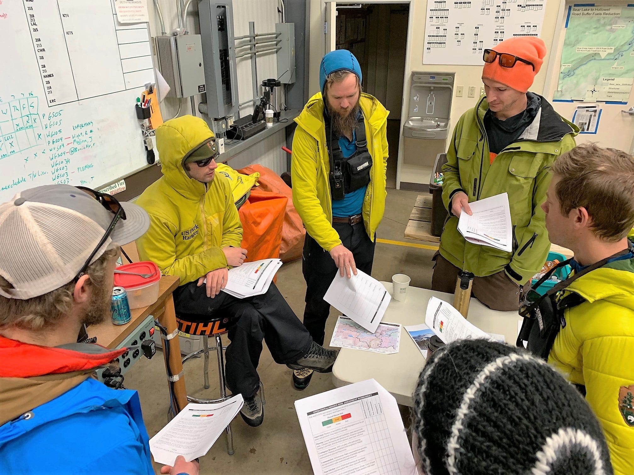 A search crew conducts a briefing Wednesday before searching for James Pruitt, 70, of Etowah, Tennessee, who is missing in Rocky Mountain National Park.
