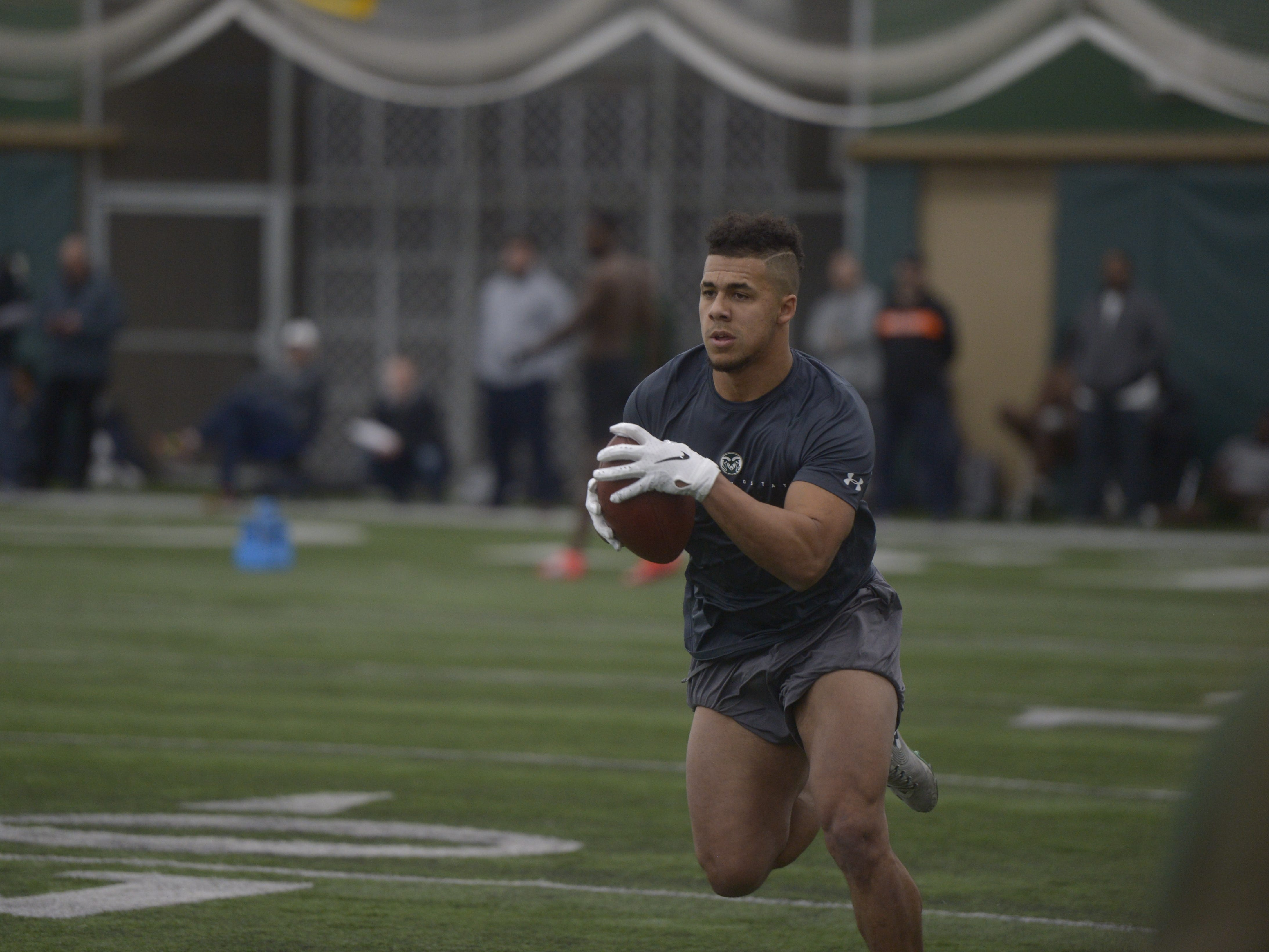 Former Colorado State running back Izzy Matthews catches passes at CSU's pro day at the Indoor Practice Facility on Wednesday, March 6, 2019.