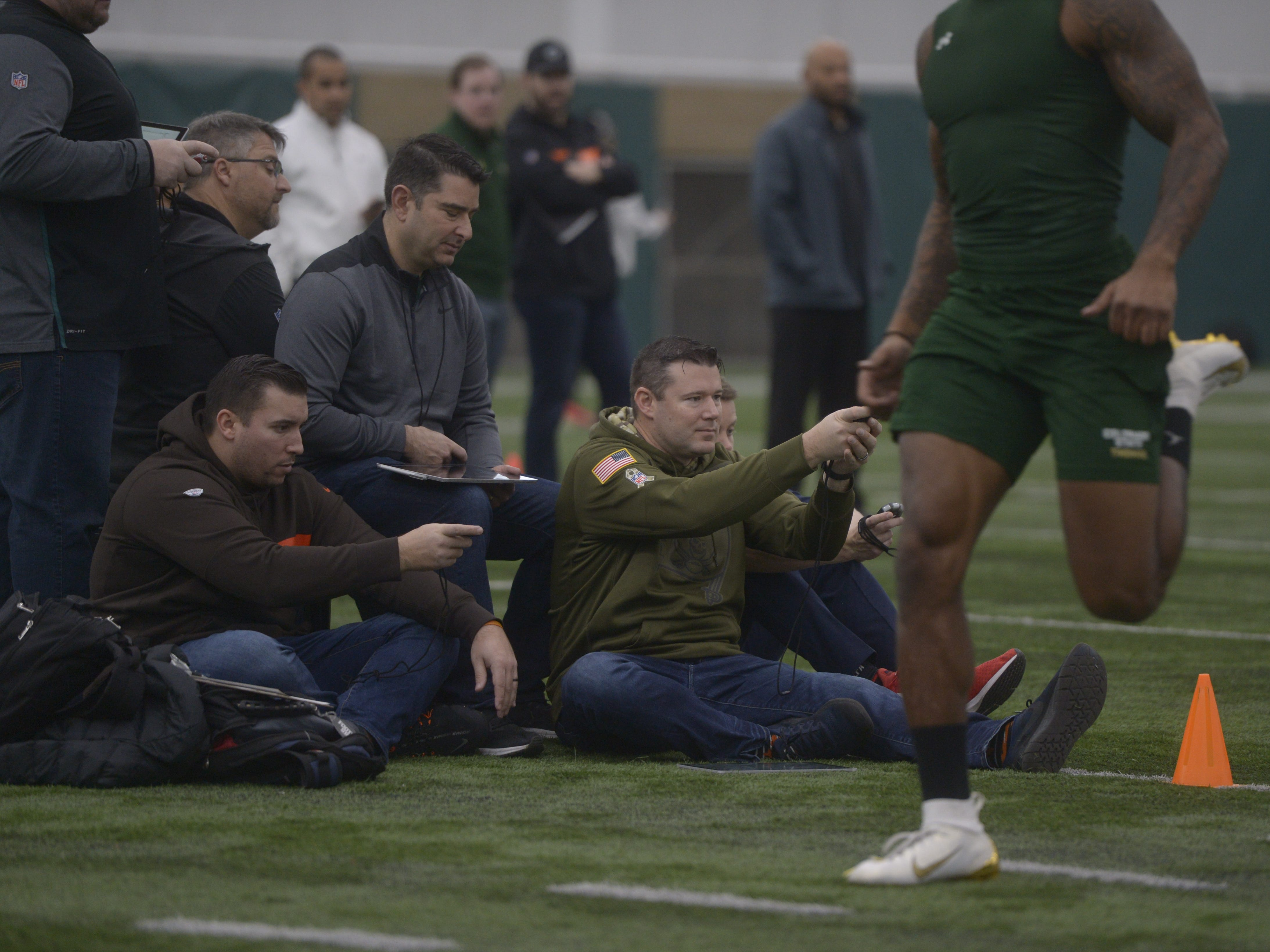 NFL scouts time 40-yard dashes at CSU's pro day in the Indoor Practice Facility on Wednesday, March 6, 2019.
