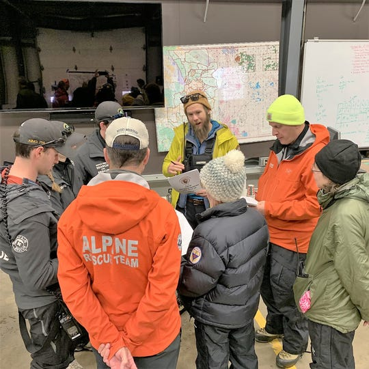 Searchers attend a briefing Wednesday as they prepare to search for James Pruitt, who went missing in Rocky Mountain National Park.