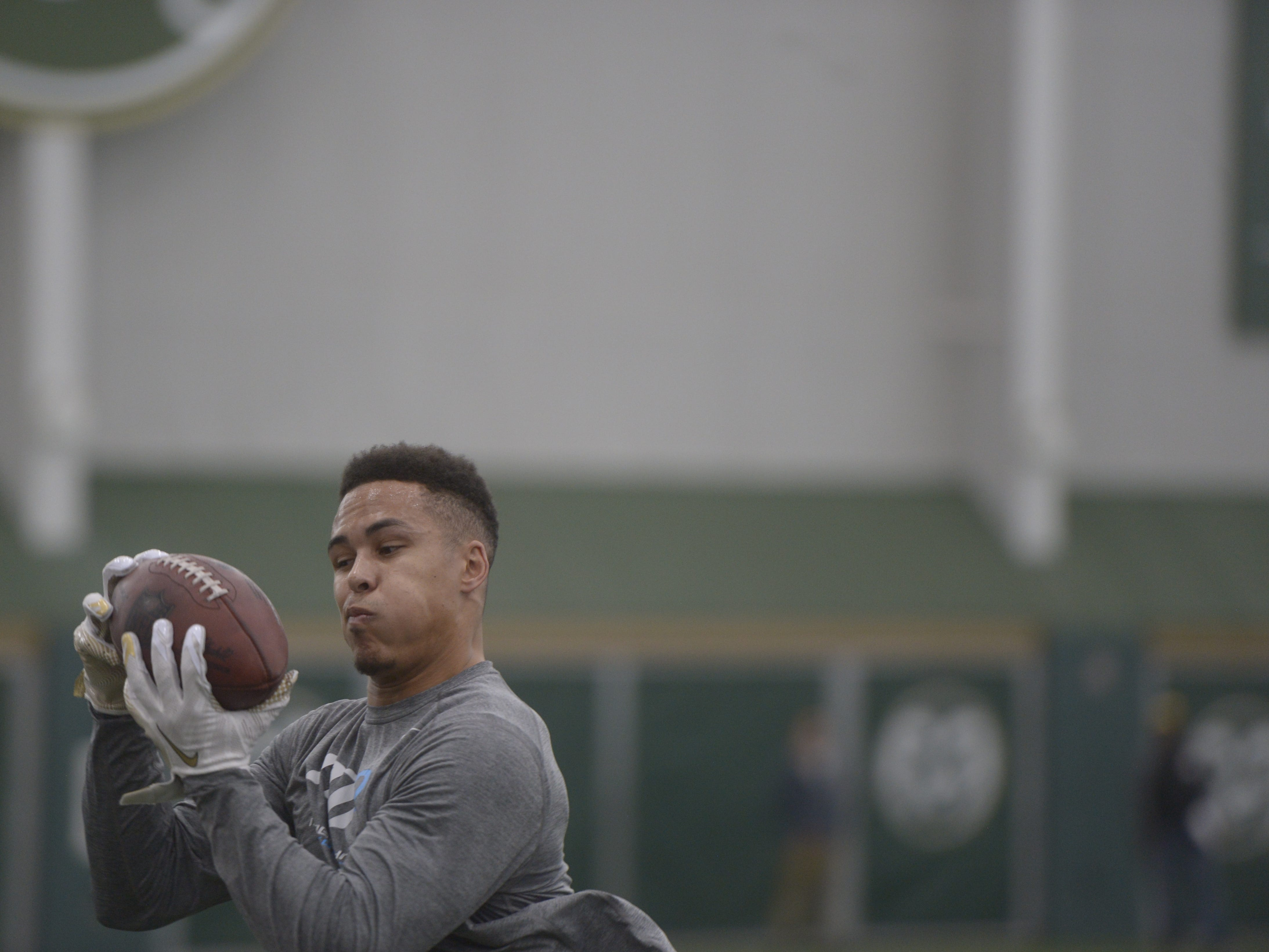 Former Colorado State receiver Bisi Johnson catches a pass at CSU's pro day in the Indoor Practice Facility on Wednesday, March 6, 2019.