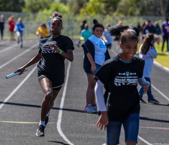 Teams were celebrates during the first unified track event for Lee County Middle Schools. Unified Sports provide opportunities for students with and without disabilities to participate in sports activities alongside one another in athletic completion. The athletes, and partners, participate together on a team that competes against other middle school teams.