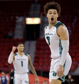 Green Bay Phoenix guard sophomore Trevian Bell (13) has played 10 more games than his rookie season thanks to the Phoenix's postseason run.