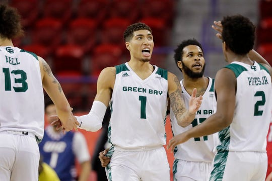Green Bay Phoenix guard Sandy Cohen III (1) high fives his teammates in a Horizon League Tournament quarterfinal against the Illinois-Chicago Flames at the Resch Center on Tuesday, March 5, 2019 in Ashwaubenon, Wis.