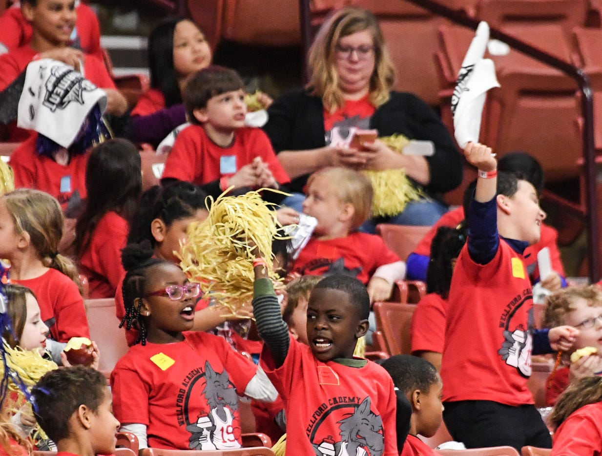 Wellford Academy of Science and Technology children cheer during the first SEC Women's basketball tournament game, Ole Miss and Florida, in Greenville Wednesday. The tournament lasts through Sunday.
