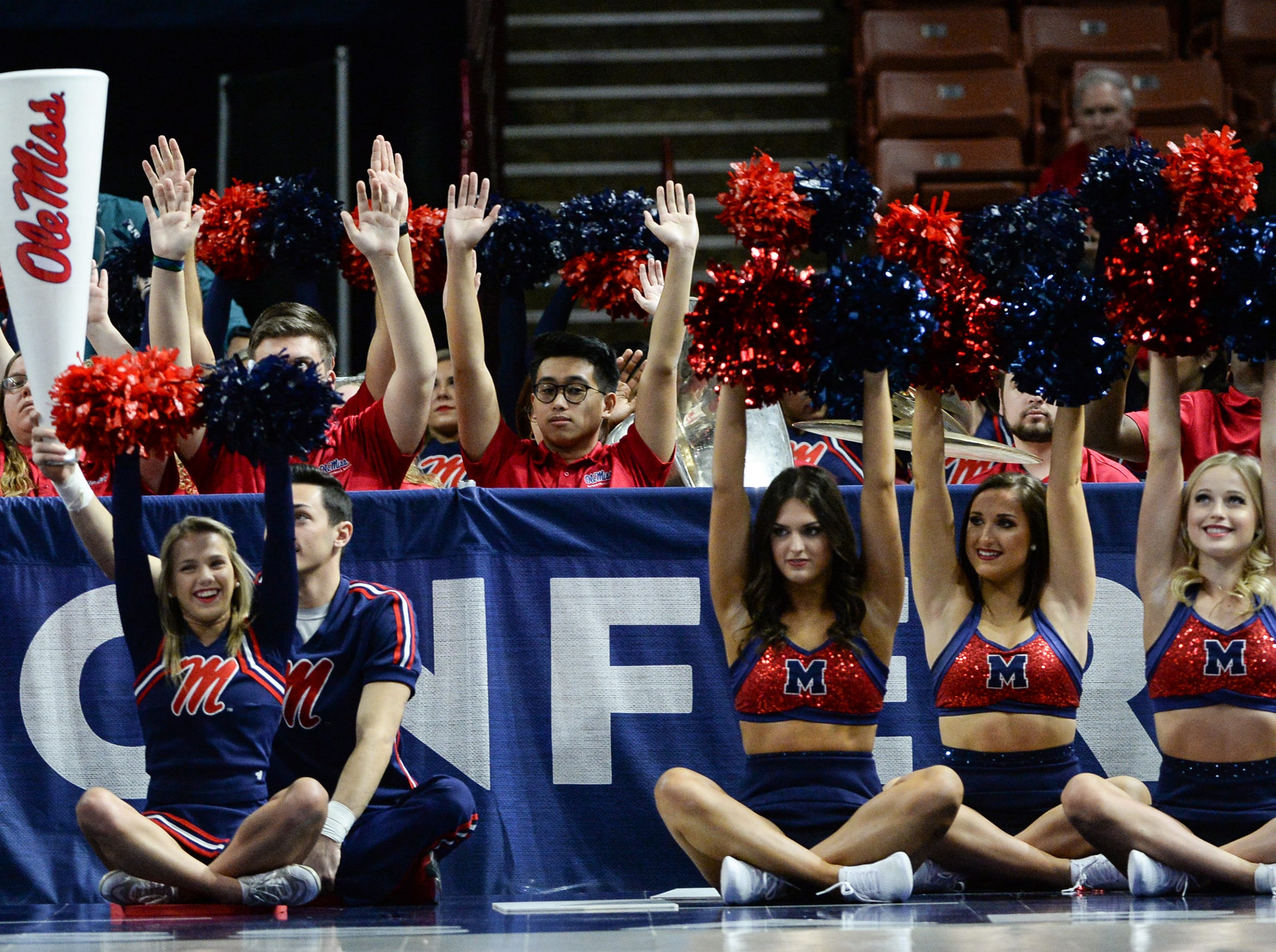 Ole Miss cheerleaders hold their hands up during the fourth quarter of the Southeastern Conference Women's Tournament game at Bon Secour Wellness Arena in Greenville Wednesday, March 6, 2019.