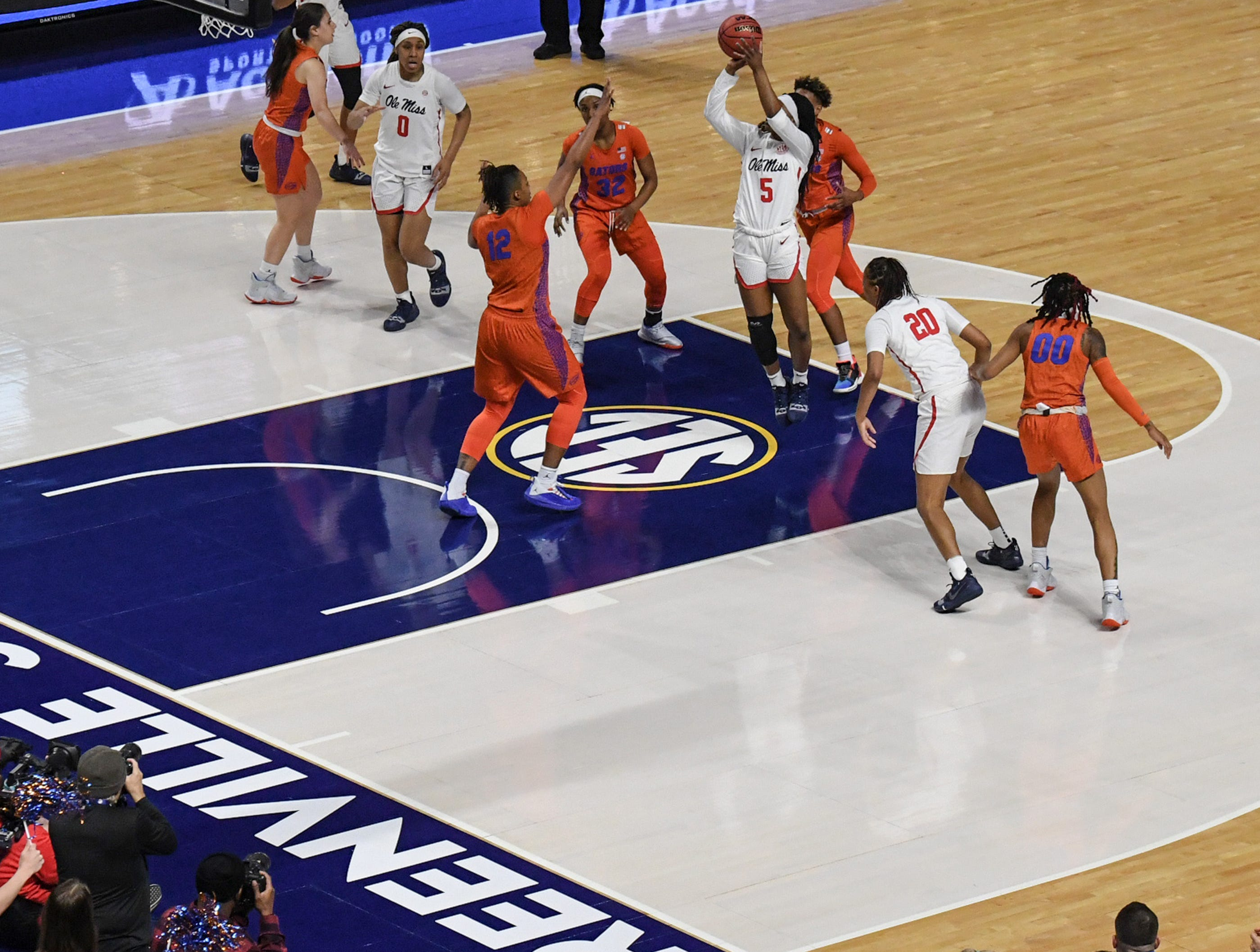 Ole Miss senior Crystal Allen(5) dribbles near Florida defenders during the first quarter of the Southeastern Conference Women's Tournament game at Bon Secour Wellness Arena in Greenville Wednesday, March 6, 2019.