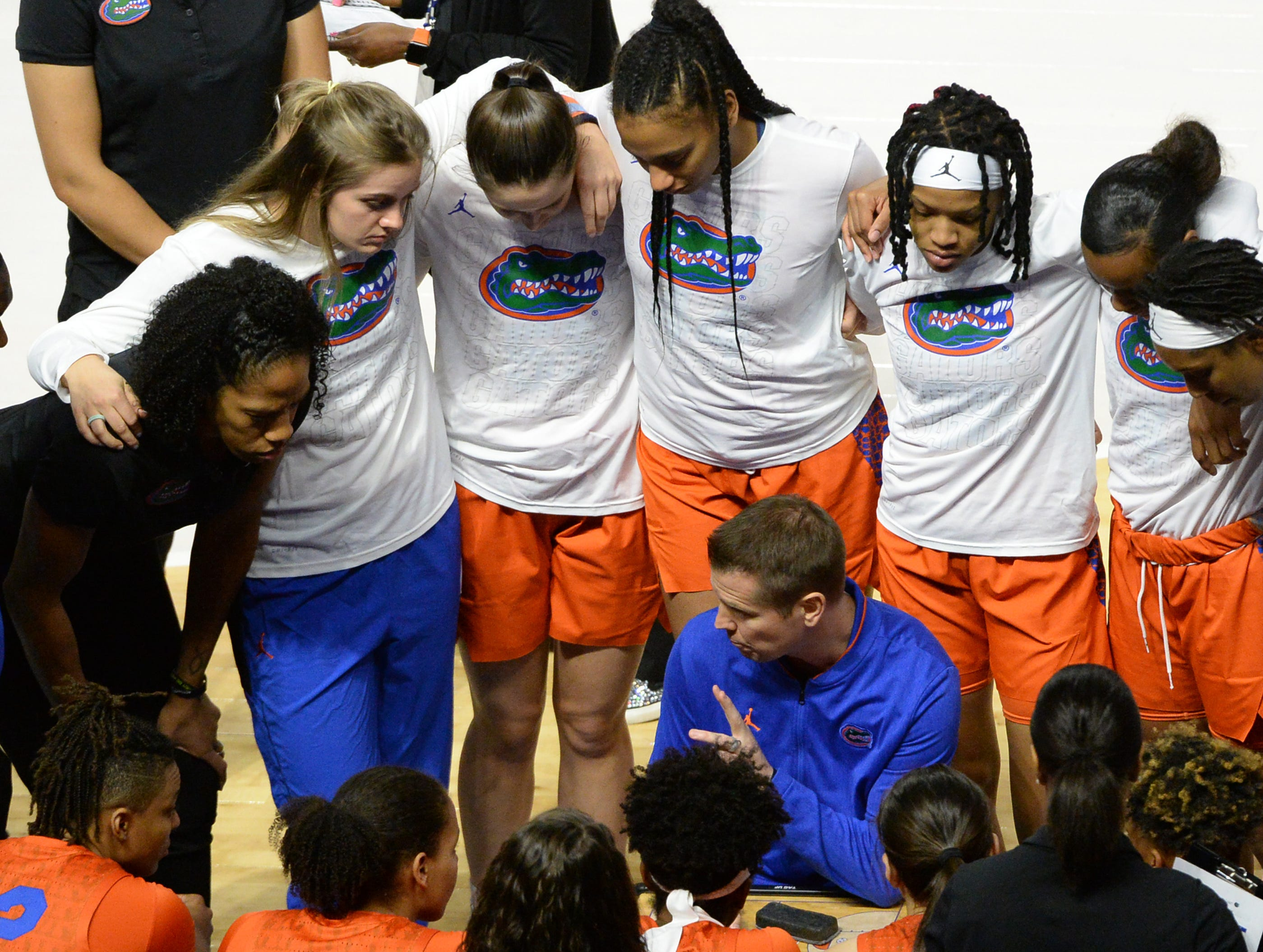 Florida Head Coach Cameron Newbauer talks with players before the Southeastern Conference Women's Tournament game at Bon Secour Wellness Arena in Greenville Wednesday, March 6, 2019.