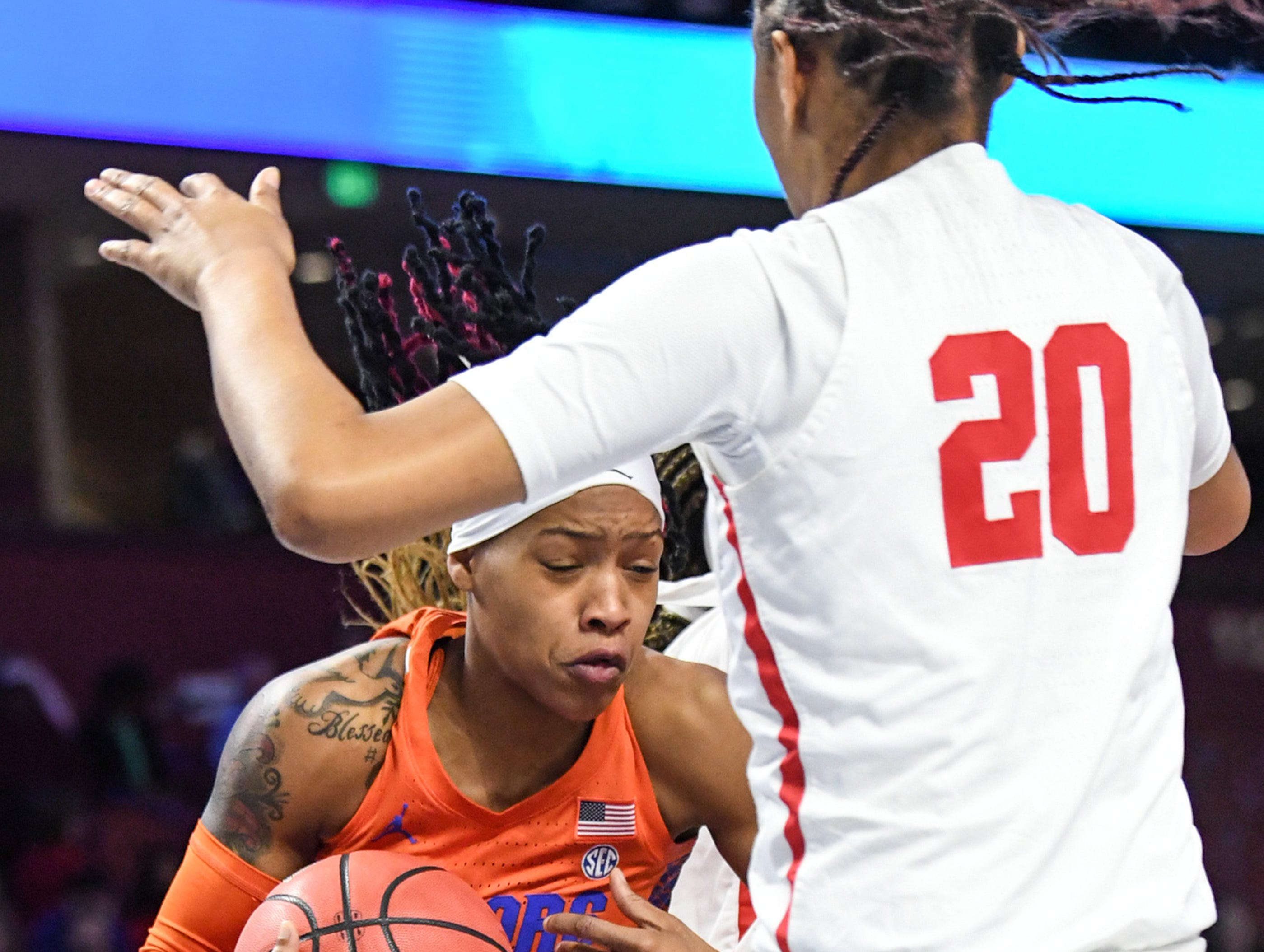Florida guard Funda Nakkasoglu(3) rebounds near Ole Miss freshman Mahogany Matthews(20) during the first quarter of the Southeastern Conference Women's Tournament game at Bon Secour Wellness Arena in Greenville Wednesday, March 6, 2019.