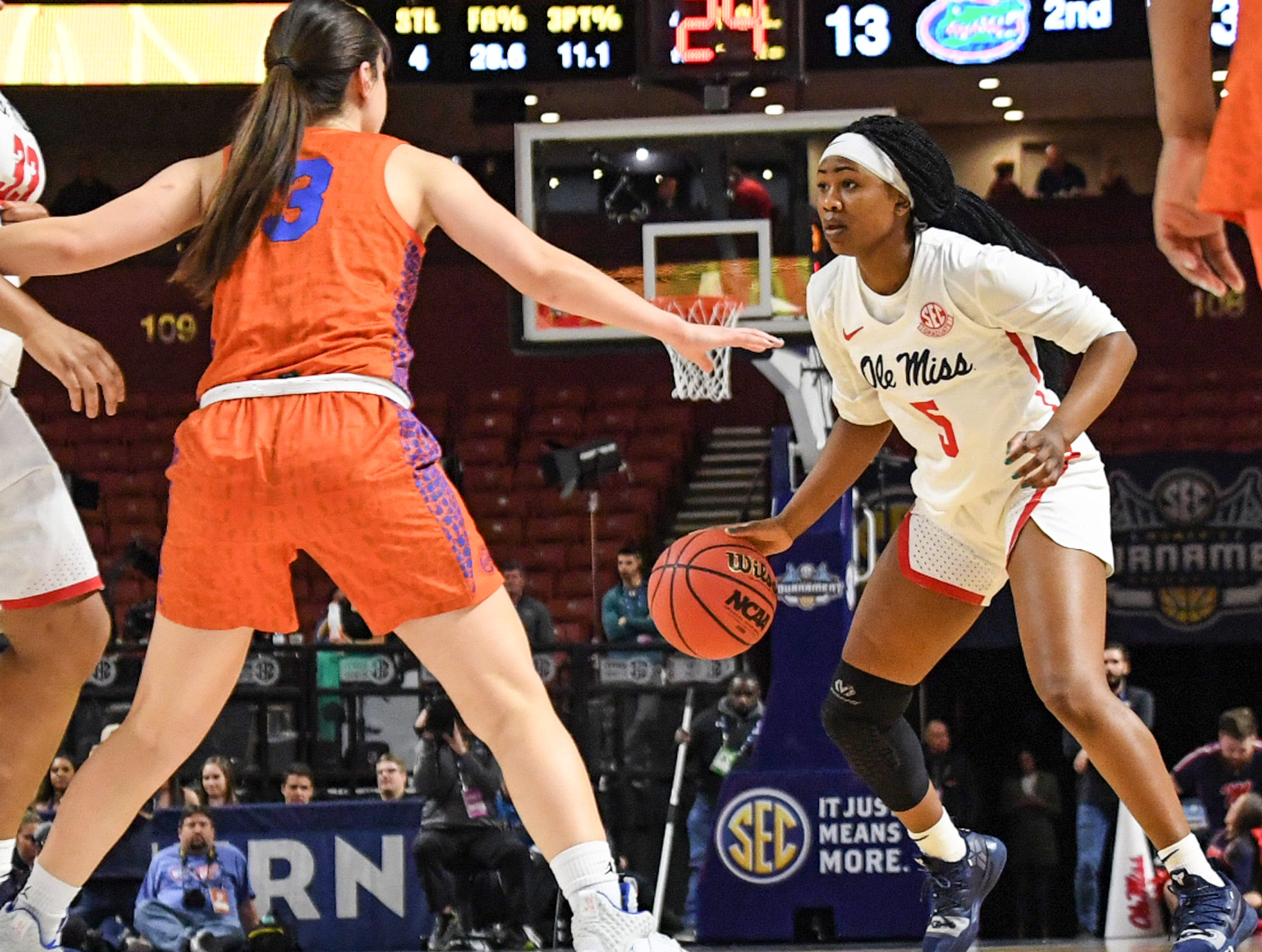 Ole Miss senior Crystal Allen(5) dribbles near Florida guard Funda Nakkasoglu(3) during the first quarter of the Southeastern Conference Women's Tournament game at Bon Secour Wellness Arena in Greenville Wednesday, March 6, 2019.