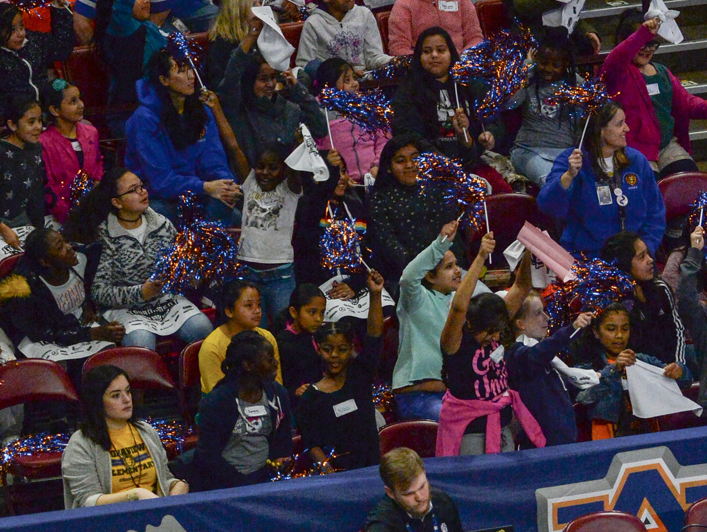 Monaview Elementary children cheer during the first SEC Women's basketball tournament game, Ole Miss and Florida, in Greenville Wednesday. The tournament lasts through Sunday.
