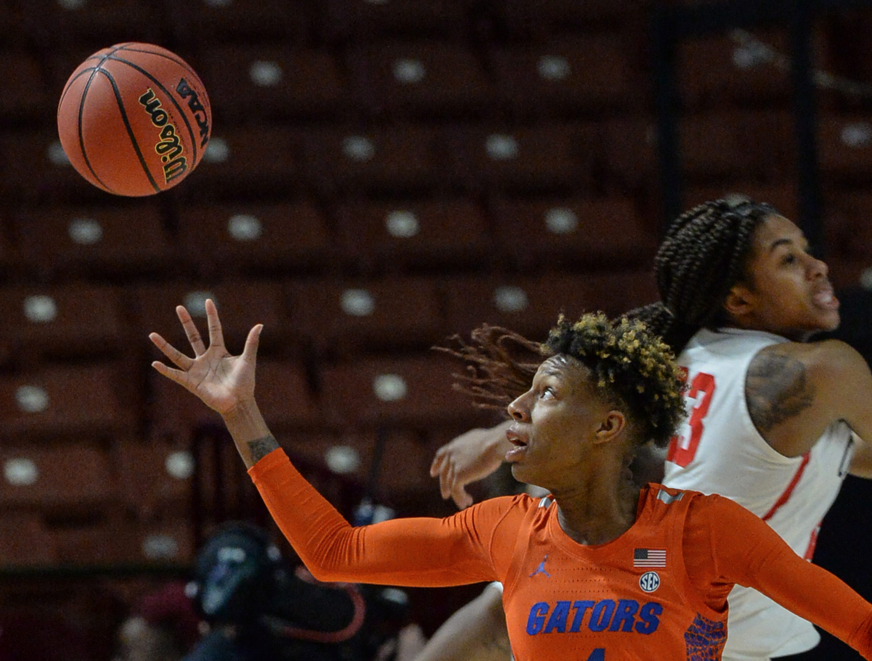 Florida guard Kiara Smith(1) reaches for a loose ball near Ole Miss senior Shandricka Sessom(23) during the fourth quarter of the Southeastern Conference Women's Tournament game at Bon Secour Wellness Arena in Greenville Wednesday, March 6, 2019.