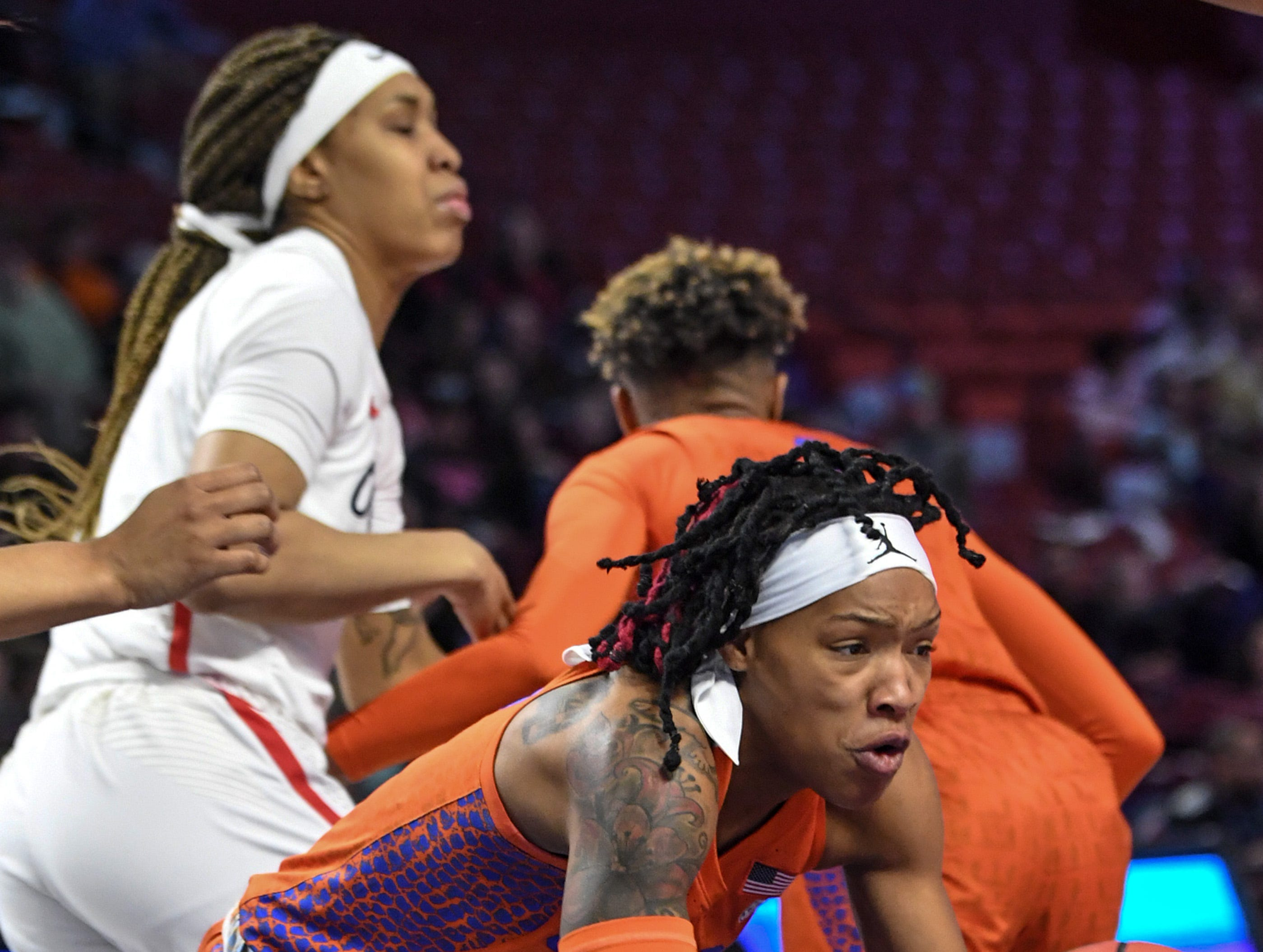 Florida forward Zada Williams rebounds near Ole Miss defenders during the first quarter of the Southeastern Conference Women's Tournament game at Bon Secour Wellness Arena in Greenville Wednesday, March 6, 2019.