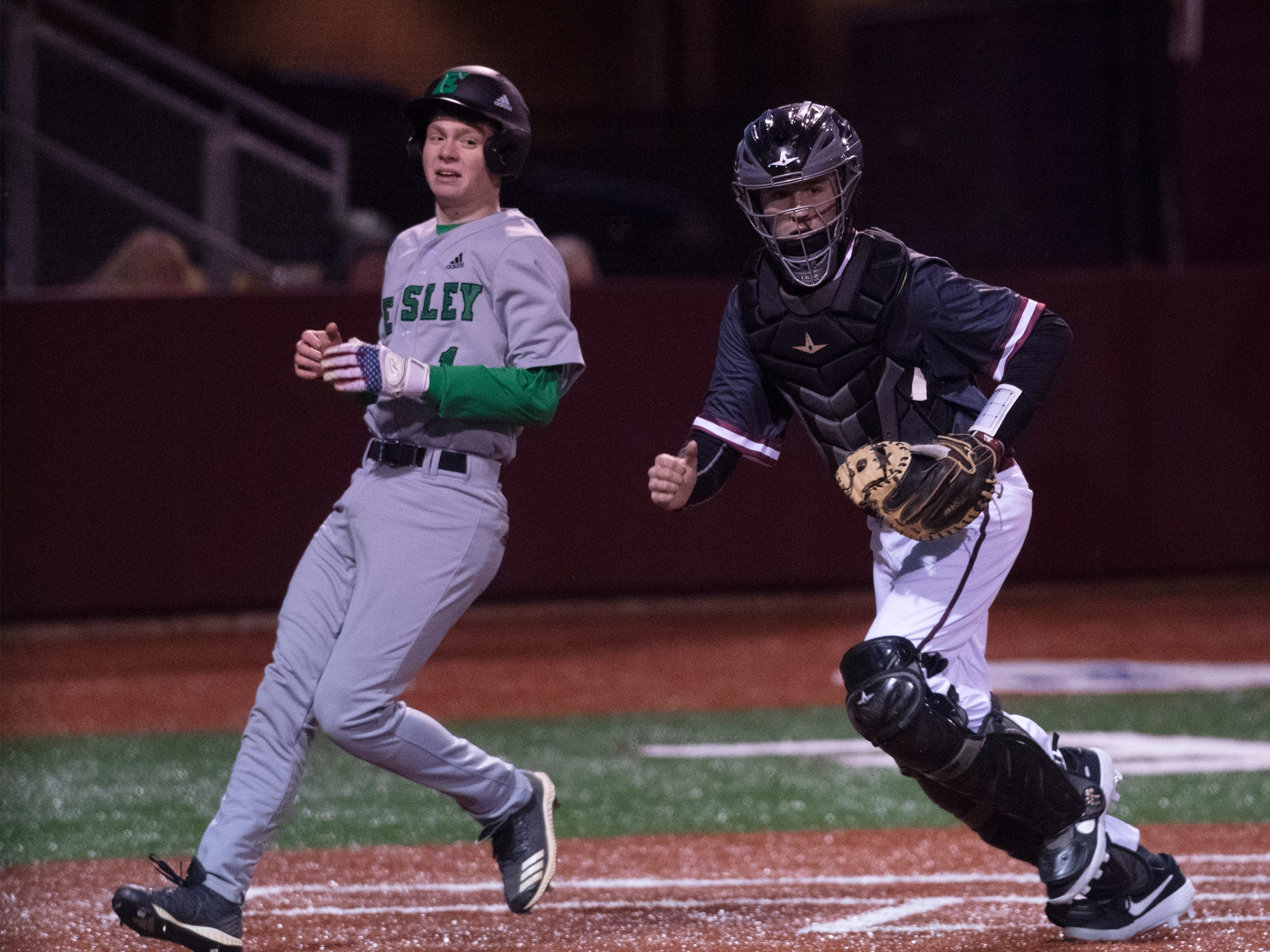 Westside High School's Jacob Bargiol (24) is at home plate while Easley High School's Ben Freeman (1) scores the second run of the game at Westside High School Tuesday, Mar. 5, 2019.