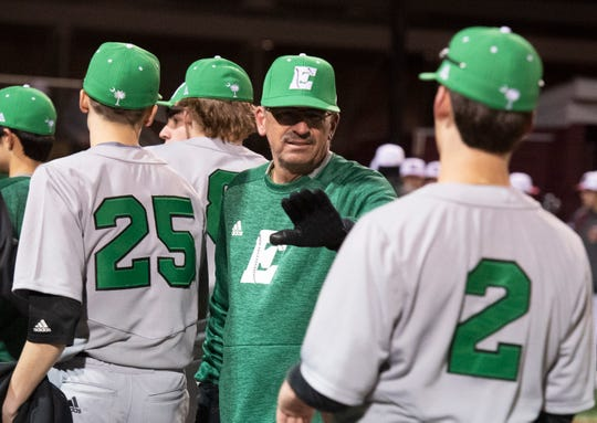 Easley High School head coach Gill Payne celebrates with his team after winning against Westside High School at Westside High School Tuesday, Mar. 5, 2019.