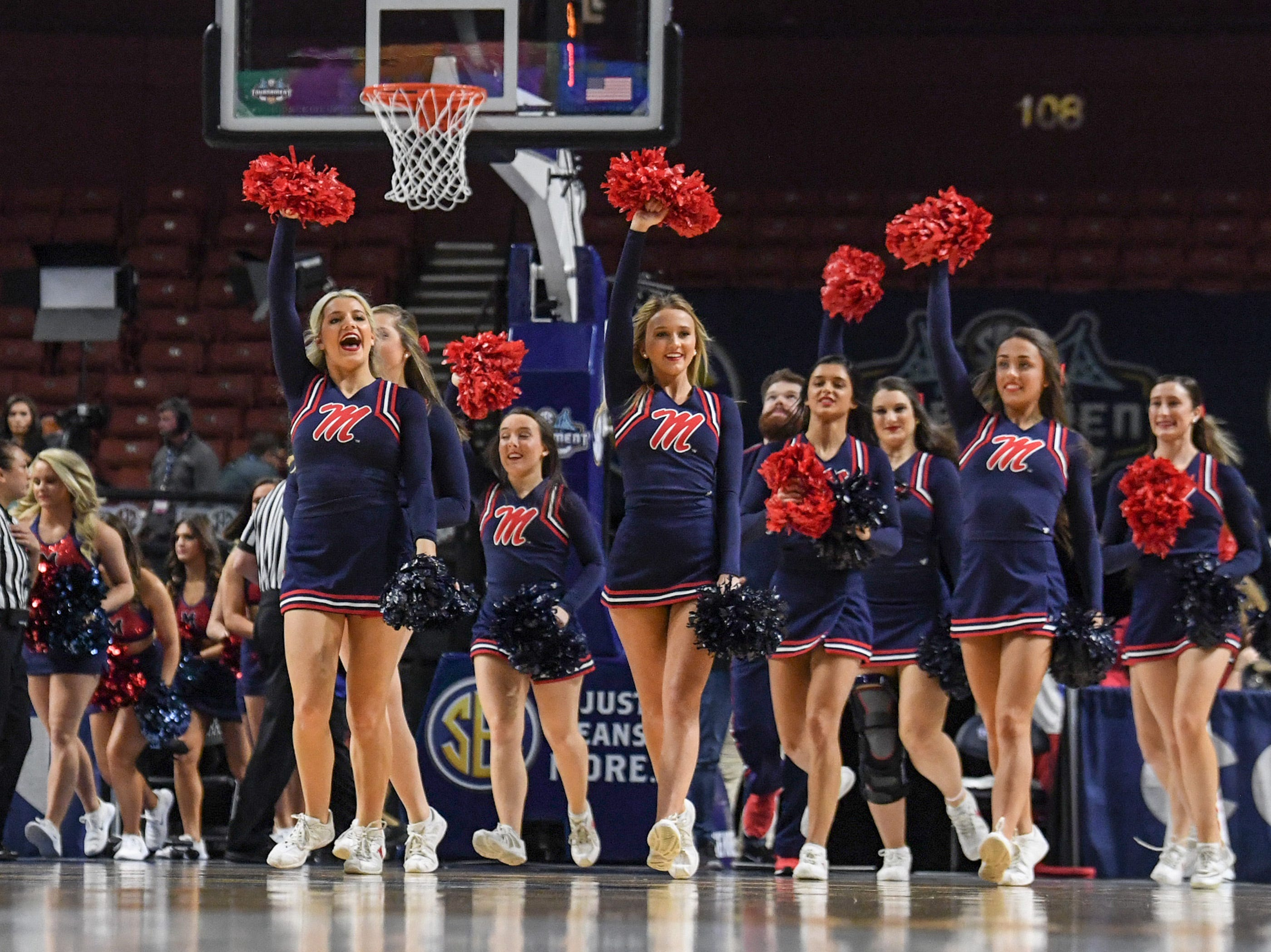 Ole Miss cheerleaders perform at a break during the fourth quarter of the Southeastern Conference Women's Tournament game at Bon Secour Wellness Arena in Greenville Wednesday, March 6, 2019.
