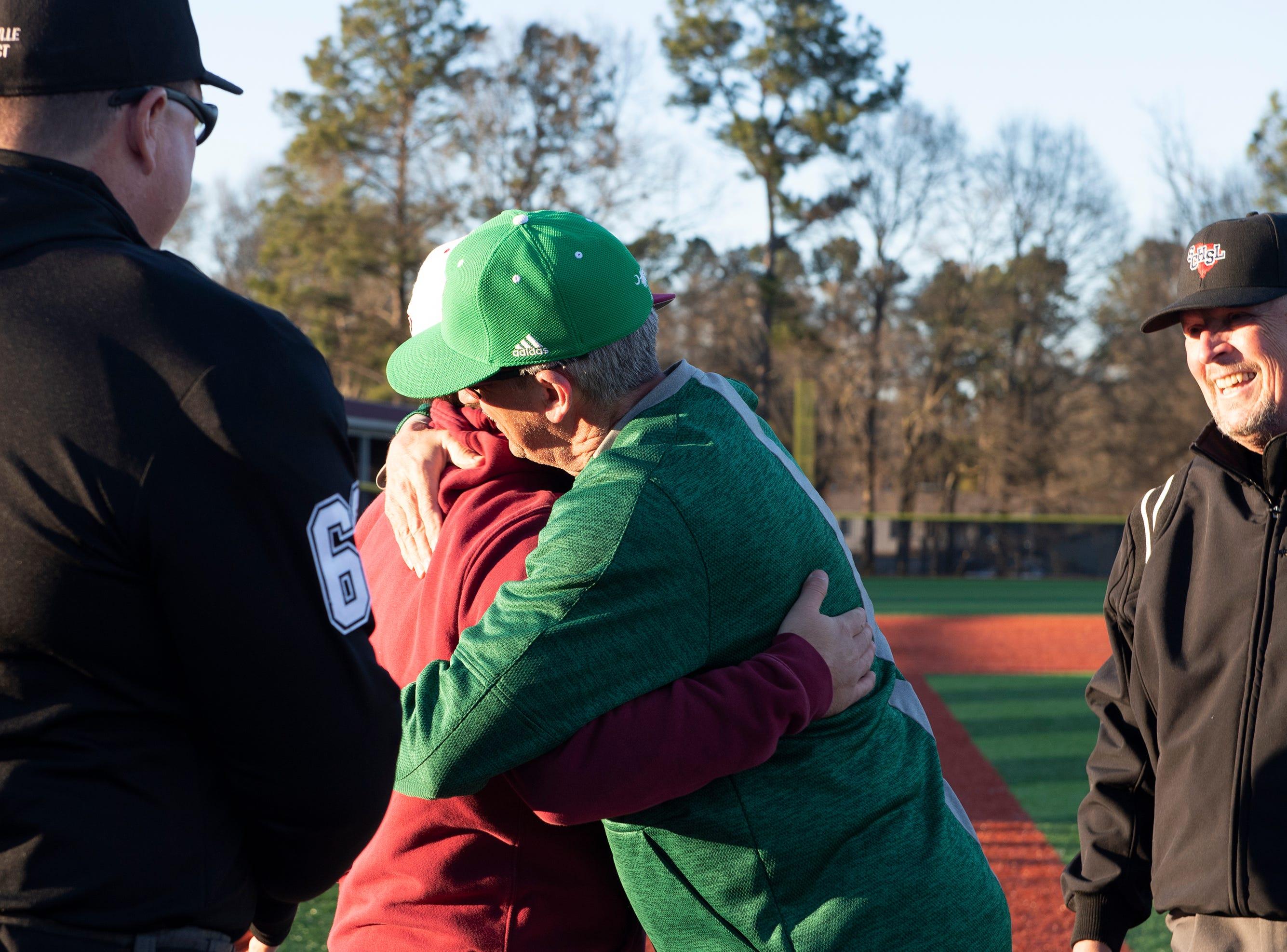 Westside High School head coach Jarrod Payne and Easley High School head coach Gill Payne hug before the start of their game at Westside High School Tuesday, Mar. 5, 2019.