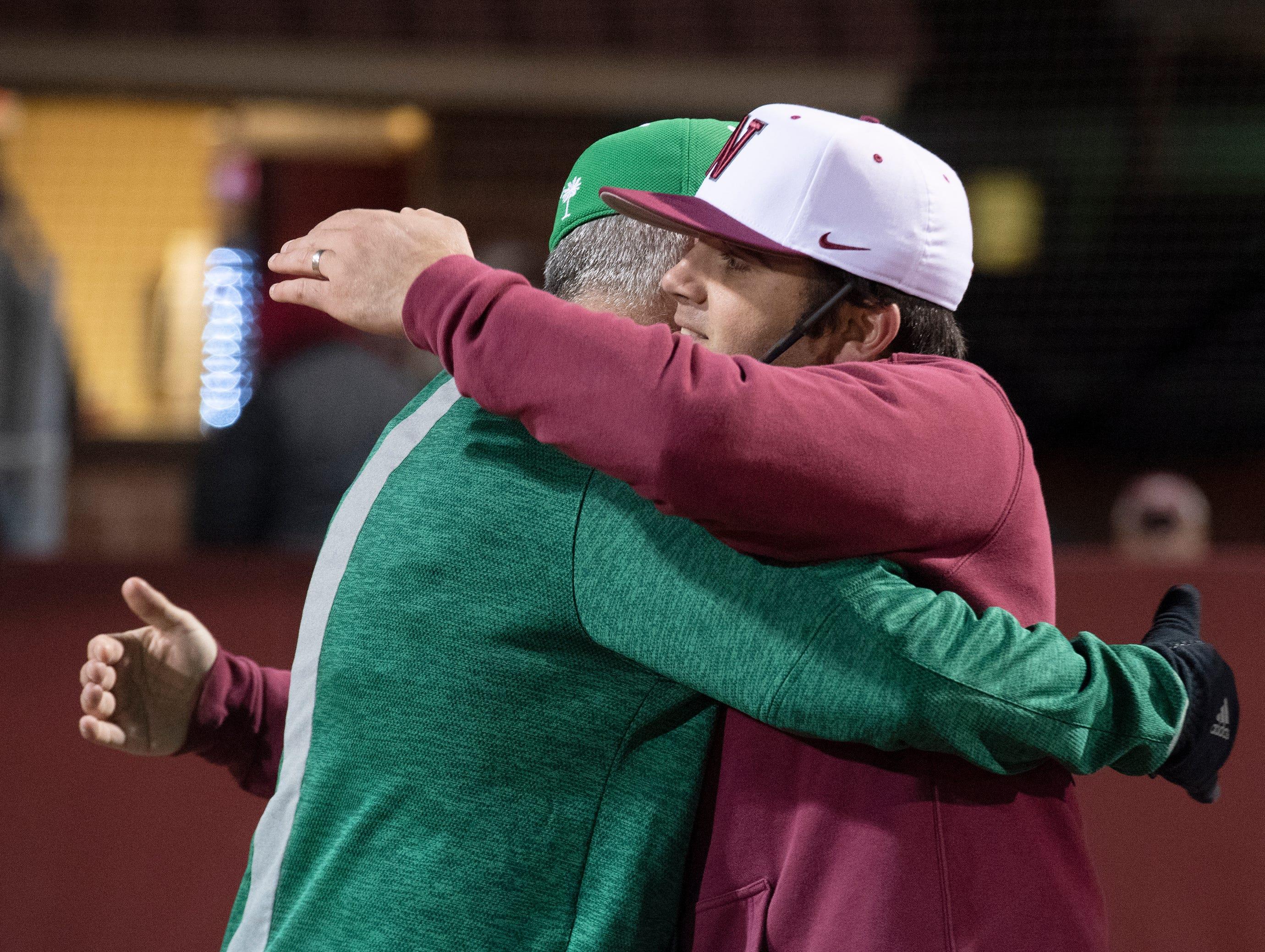 Easley High School head coach Gill Payne (left) and his son Westside High School head coach Jarrod Payne hug after their game at Westside High School Tuesday, Mar. 5, 2019.