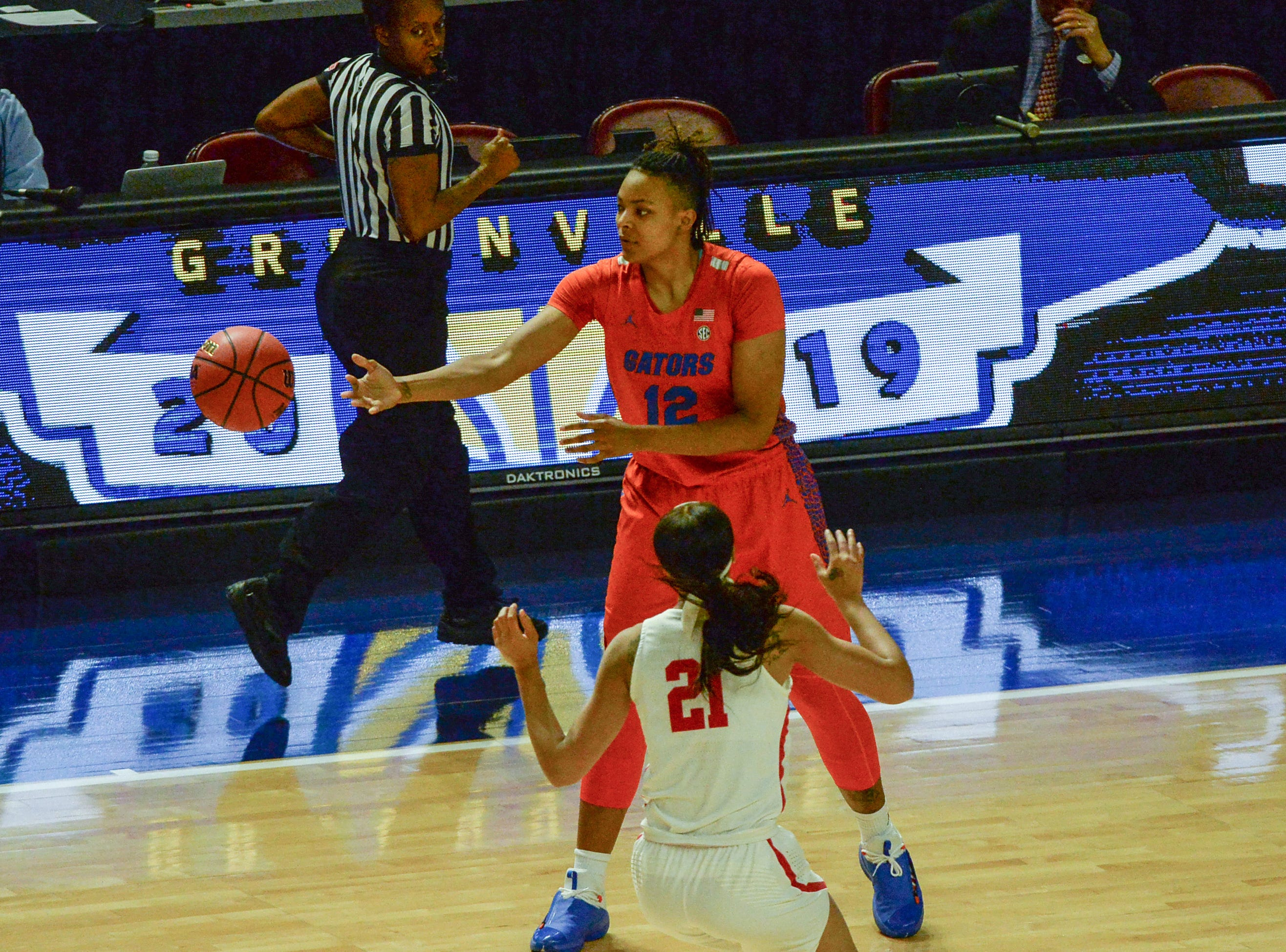 Florida forward Zada Williams (12) passes near Ole Miss freshman Taylor Smith(21) during the first quarter of the Southeastern Conference Women's Tournament game at Bon Secour Wellness Arena in Greenville Wednesday, March 6, 2019.