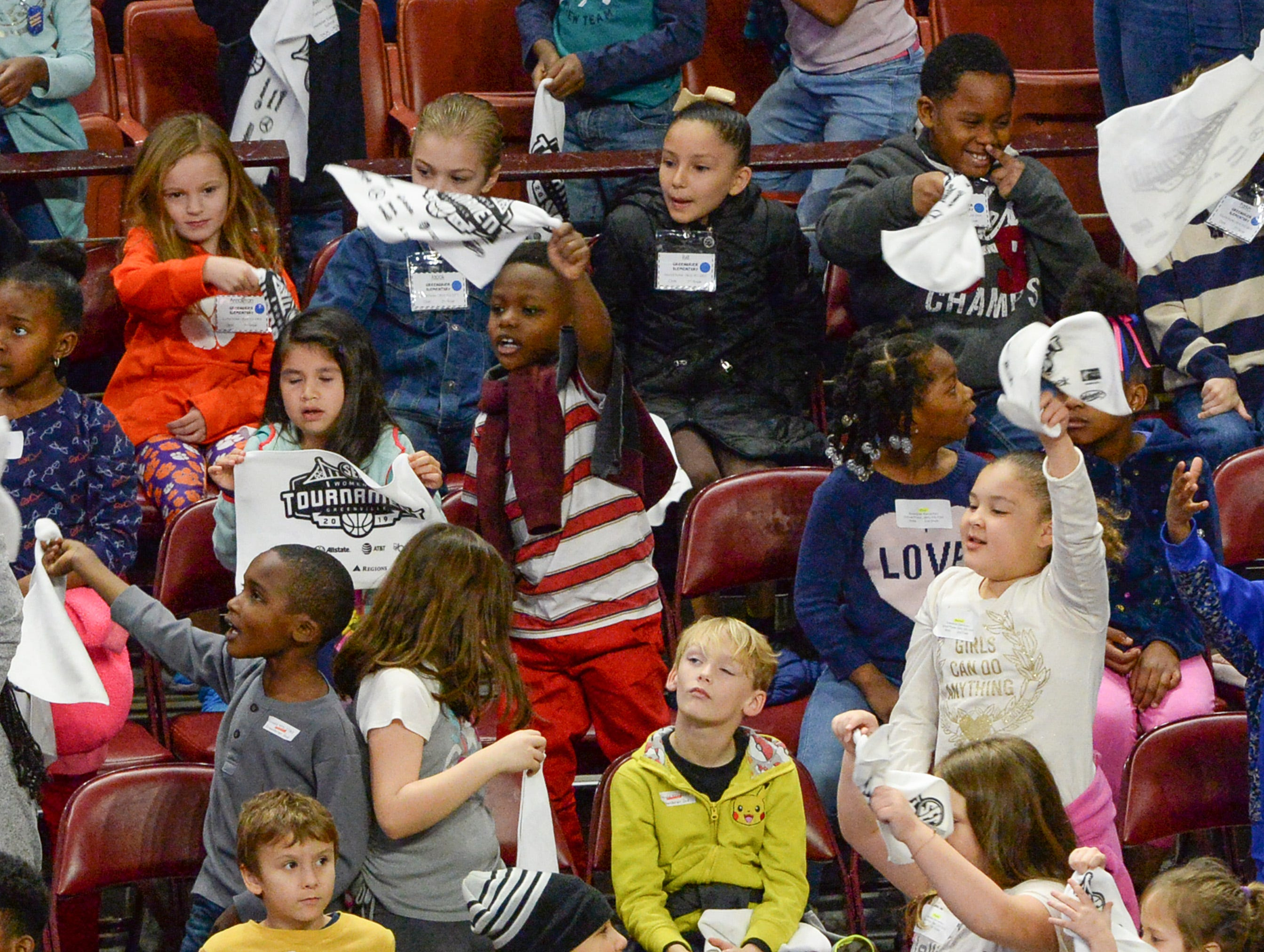 Greenbriar Elementary wave towels cheering during the first SEC Women's basketball tournament game, Ole Miss and Florida, in Greenville Wednesday. The tournament lasts through Sunday.