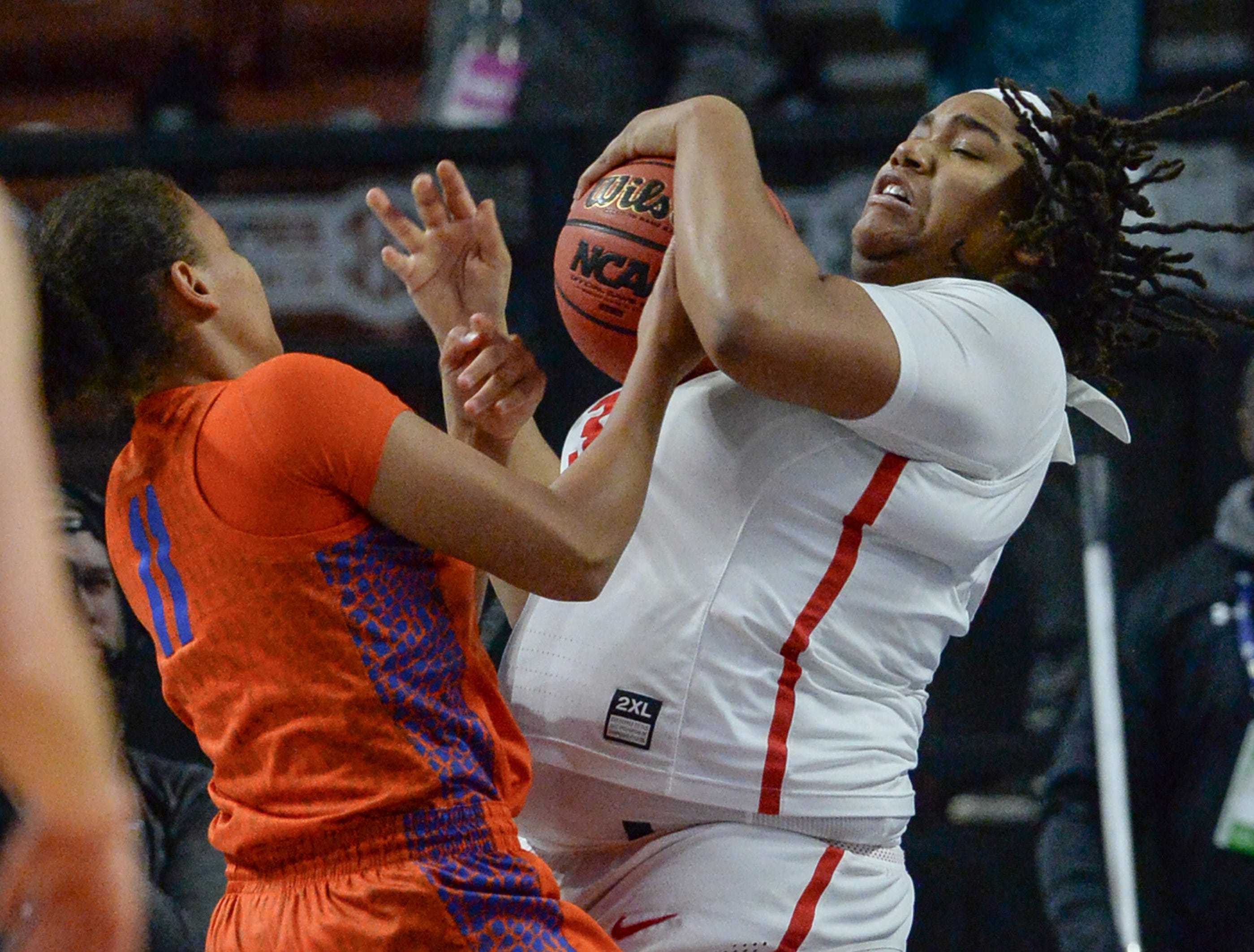 Florida guard Emanuely de Oliveira(11) pressures Ole Miss senior La'Karis Salter(33) during the fourth quarter of the Southeastern Conference Women's Tournament game at Bon Secour Wellness Arena in Greenville Wednesday, March 6, 2019.