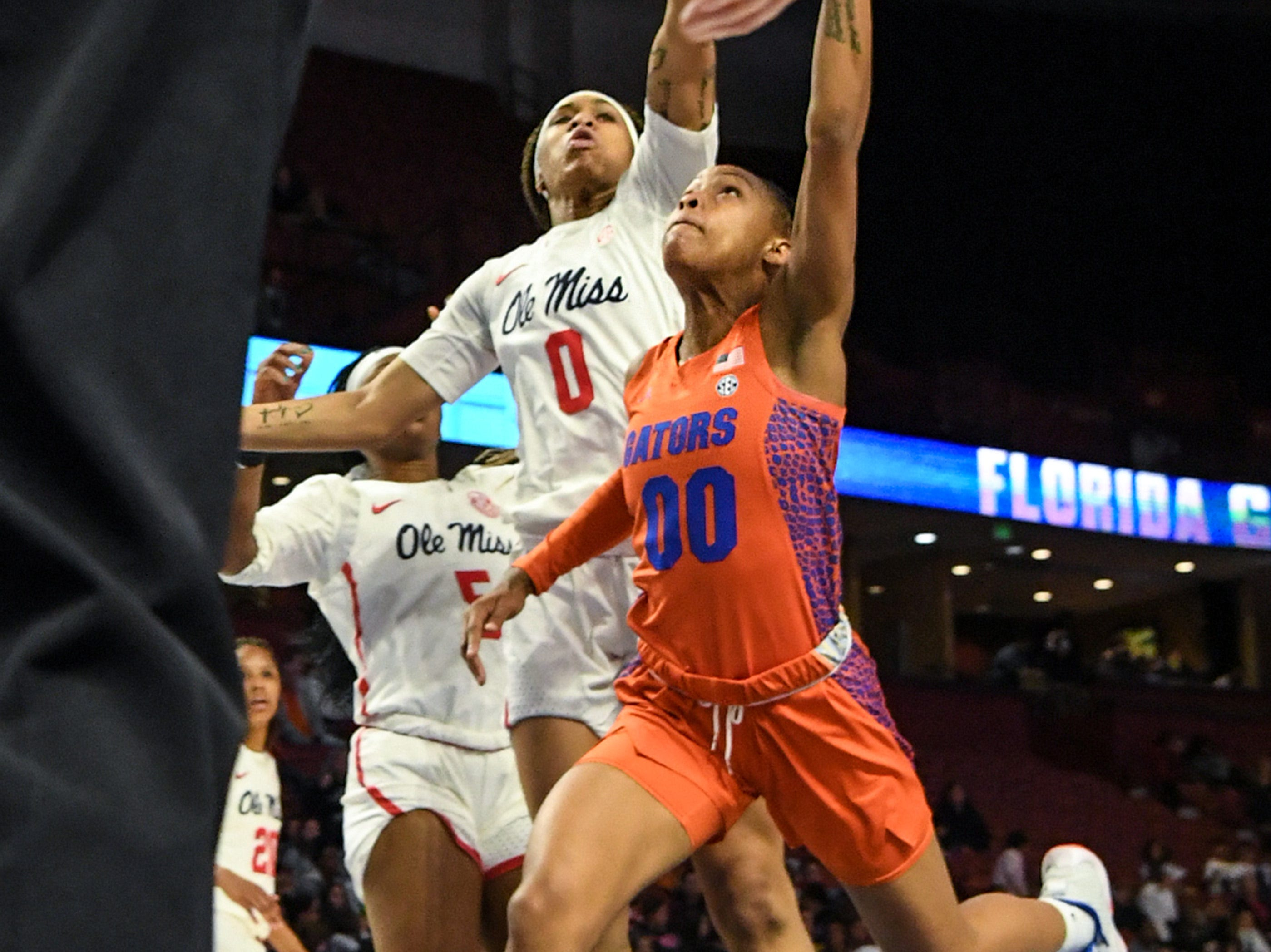 Florida forward Emer Nichols(30) shoots near Ole Miss freshman Gabby Crawford(0) during the fourth quarter of the Southeastern Conference Women's Tournament game at Bon Secour Wellness Arena in Greenville Wednesday, March 6, 2019.