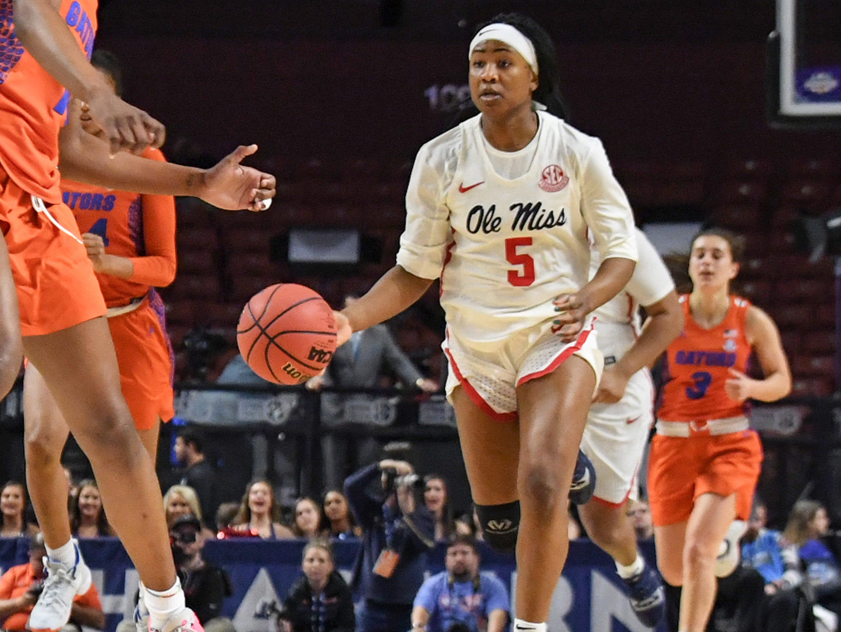 Ole Miss senior Crystal Allen(5) dribbles against Florida during the fourth quarter of the Southeastern Conference Women's Tournament game at Bon Secour Wellness Arena in Greenville Wednesday, March 6, 2019.