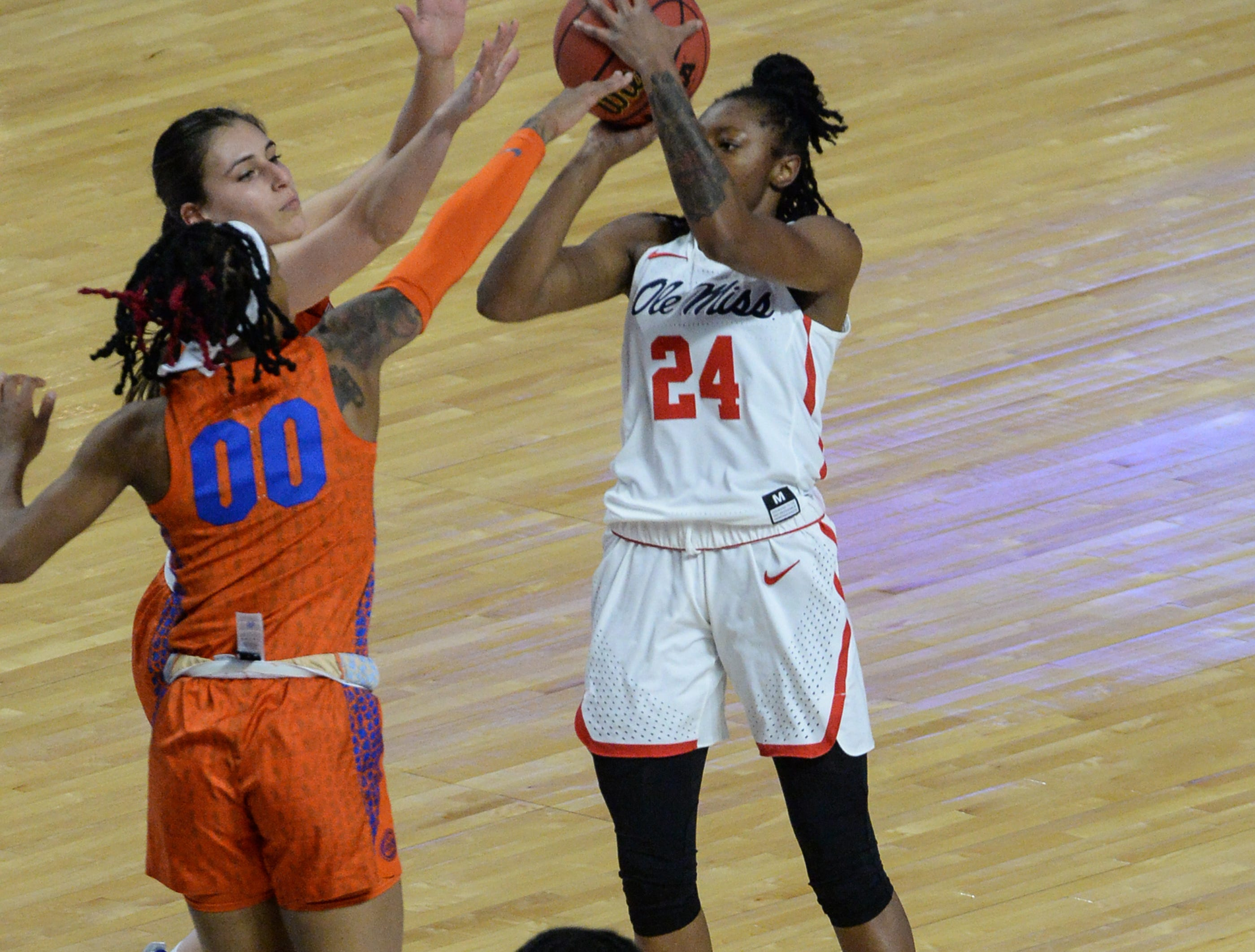 Ole Miss junior Shannon Dozier(24) shoots near Florida guard Delicia Washington(0) during the first quarter of the Southeastern Conference Women's Tournament game at Bon Secour Wellness Arena in Greenville Wednesday, March 6, 2019.
