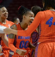 Florida guard Delicia Washington(0) celebrates with teammates a win over Ole Miss in the Southeastern Conference Women's Tournament game at Bon Secour Wellness Arena in Greenville Wednesday, March 6, 2019.