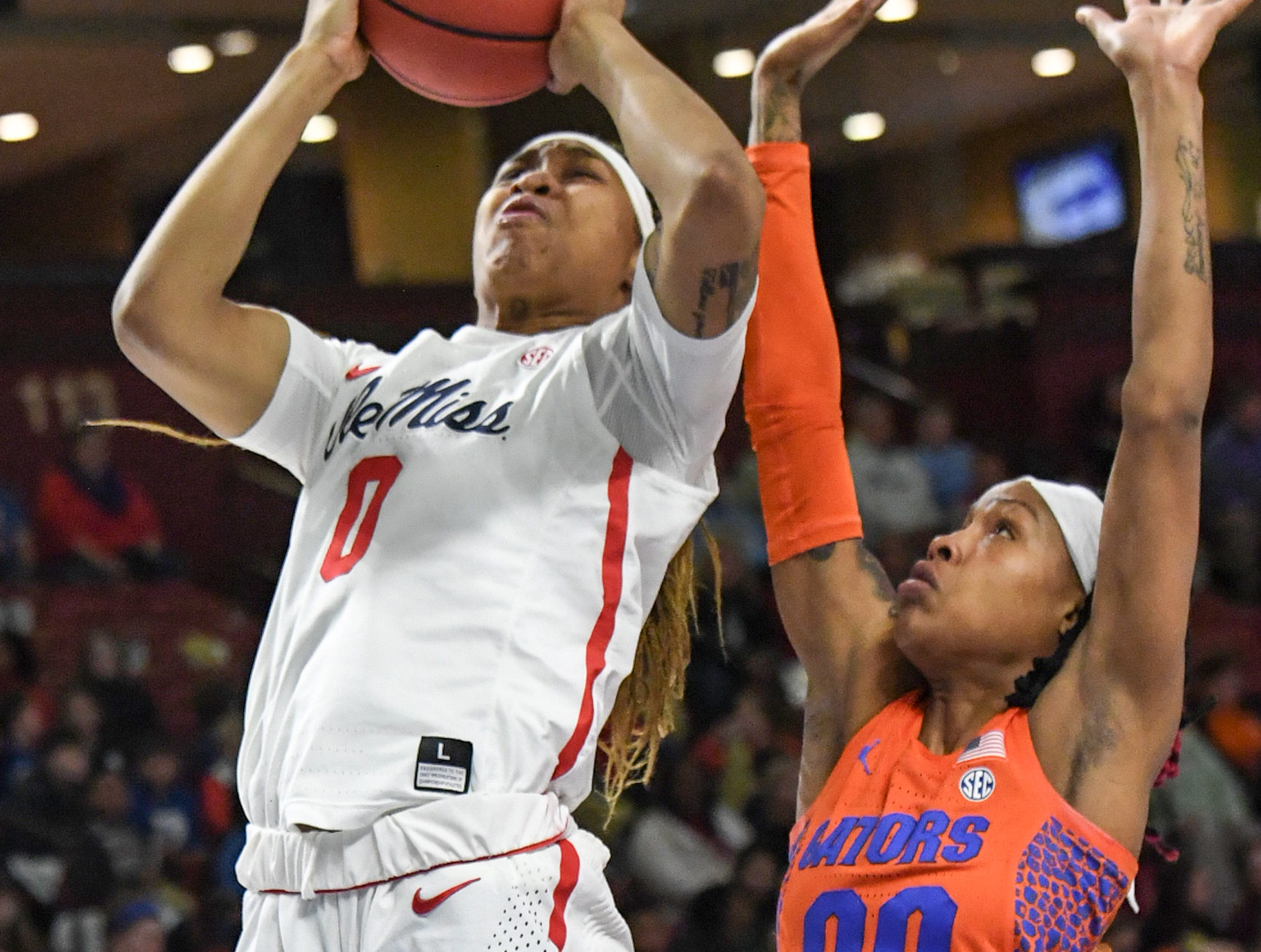 Ole Miss freshman Gabby Crawford(0) shoots near Florida guard Delicia Washington(0) during the first quarter of the Southeastern Conference Women's Tournament game at Bon Secour Wellness Arena in Greenville Wednesday, March 6, 2019.