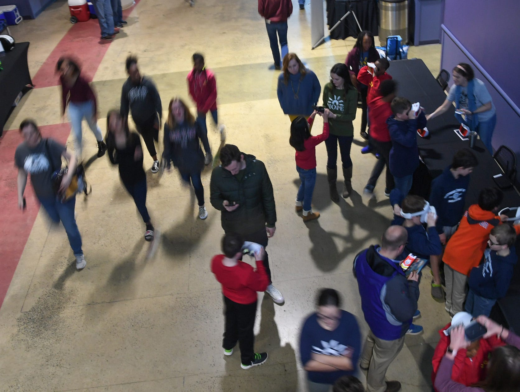 Fans arrive before the first SEC Women's basketball tournament game, Ole Miss and Florida, in Greenville Wednesday. The tournament lasts through Sunday.