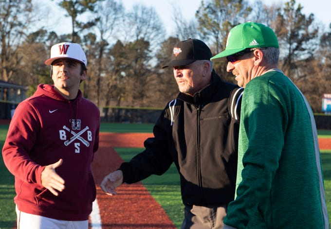 Westside High School head coach Jarrod Payne and Easley High School head coach Gill Payne shake hands with the umpires before the start of their game at Westside High School Tuesday, Mar. 5, 2019.