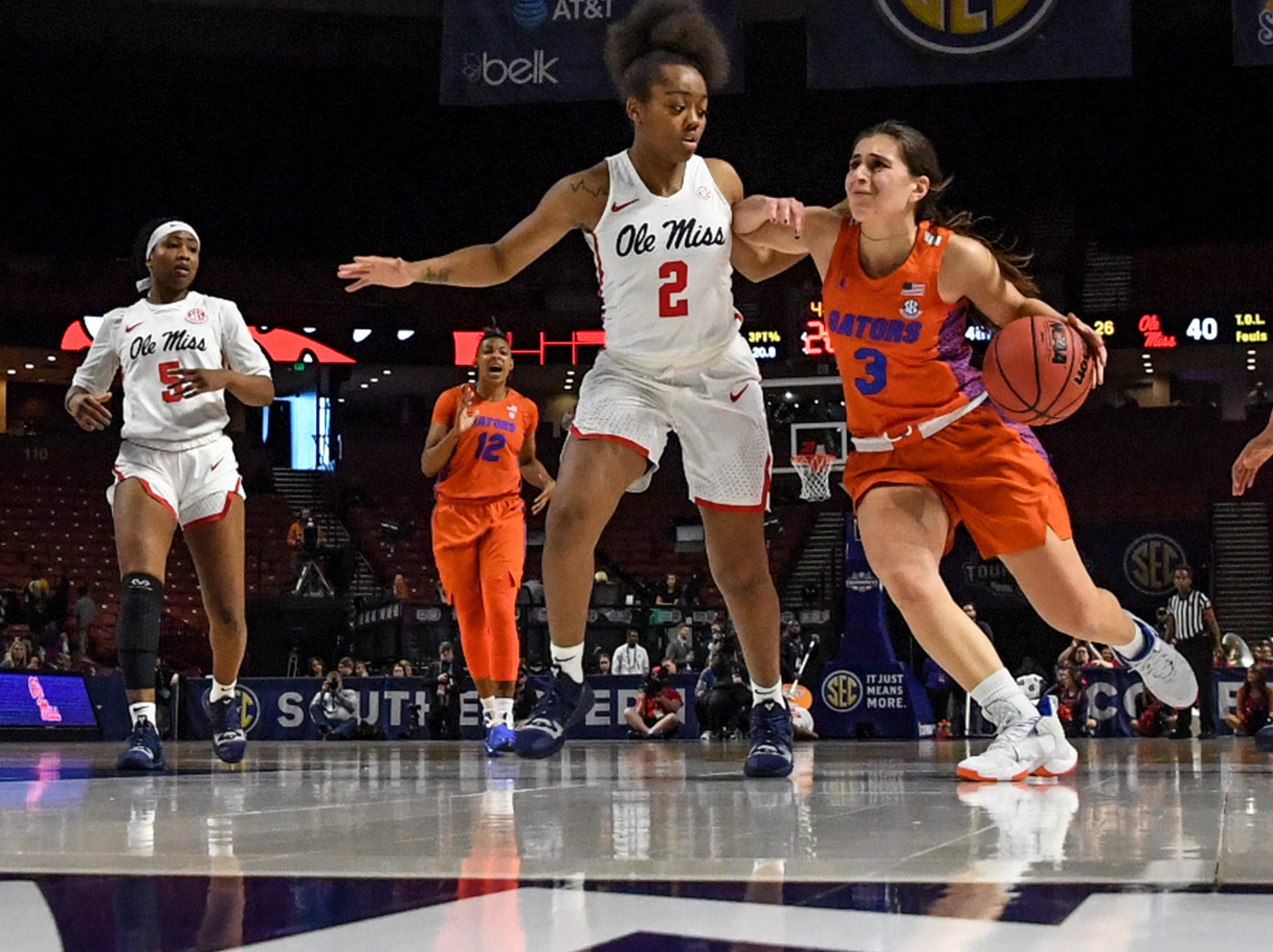 Florida guard Funda Nakkasoglu(3) dribbles around Ole Miss freshman Mimi Reid(2) during the fourth quarter of the Southeastern Conference Women's Tournament game at Bon Secour Wellness Arena in Greenville Wednesday, March 6, 2019.