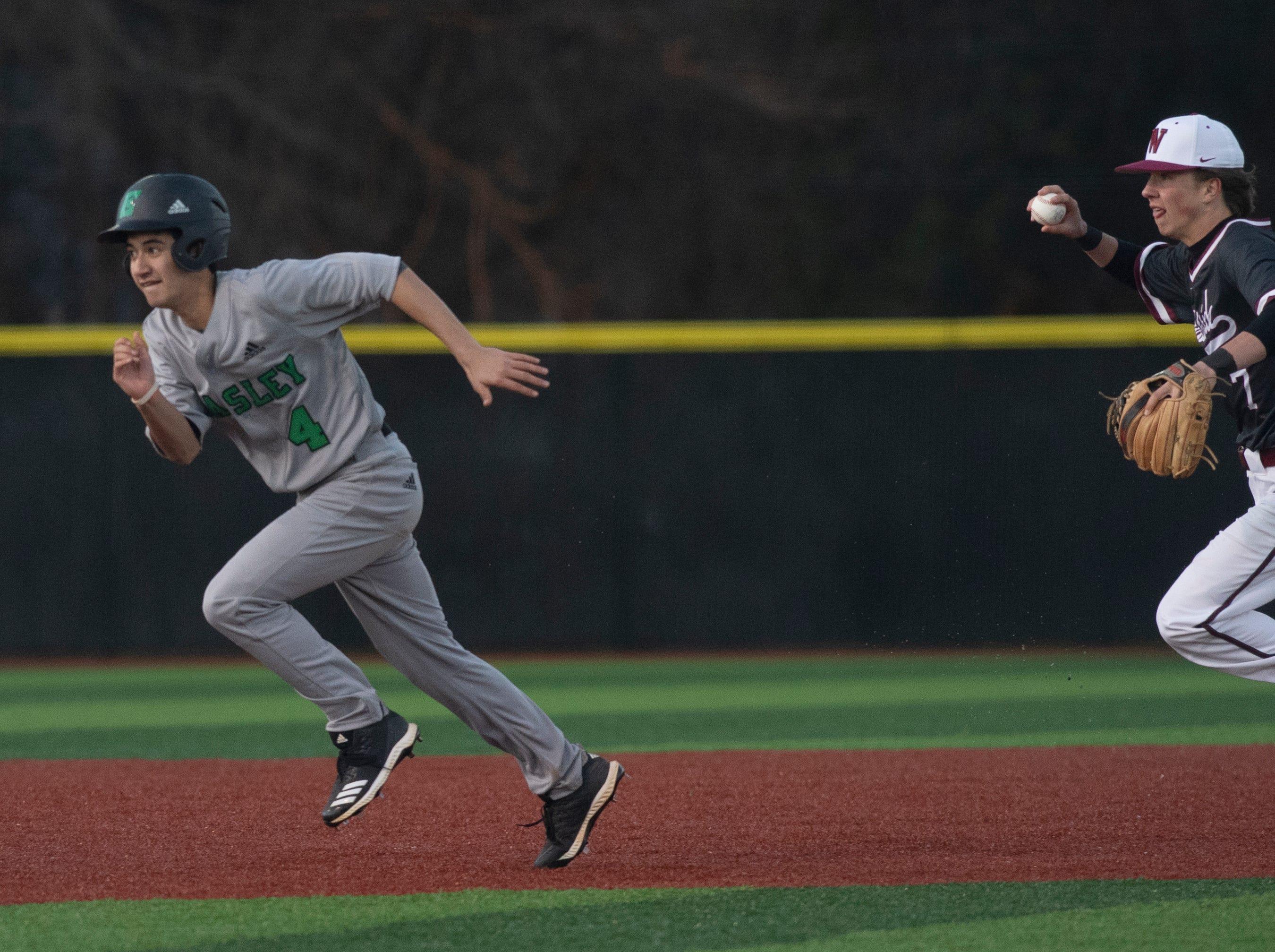 Westside High School's Cade Langston (7) chases Easley High School's Logan Mackey (4) before Mackey is tagged by Westside High School's Jaden Cribb (9) during the game  at Westside High School Tuesday, Mar. 5, 2019.