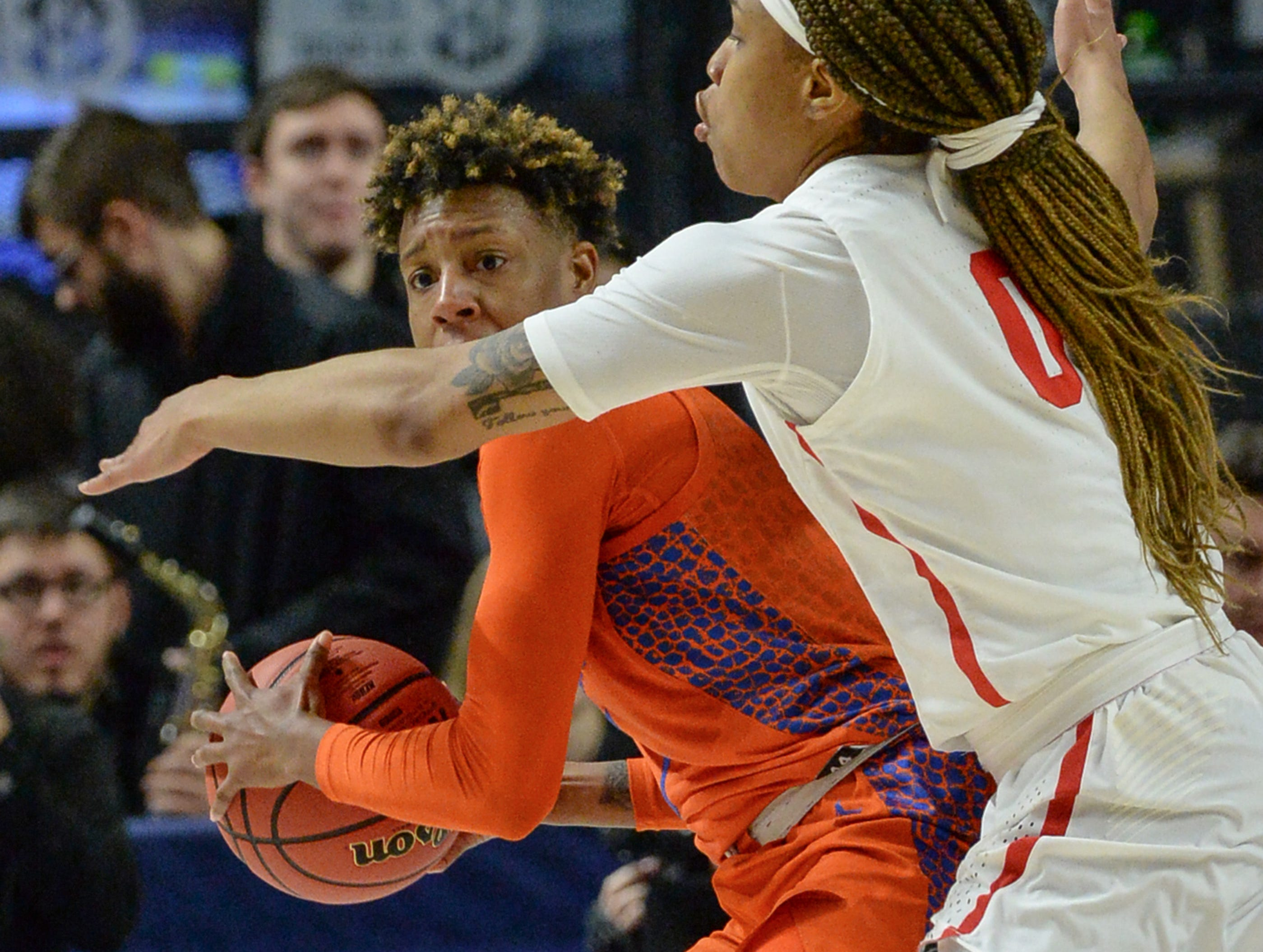 Florida guard Kiara Smith(1) looks to pass near Ole Miss freshman Gabby Crawford(0) during the fourth quarter of the Southeastern Conference Women's Tournament game at Bon Secour Wellness Arena in Greenville Wednesday, March 6, 2019.